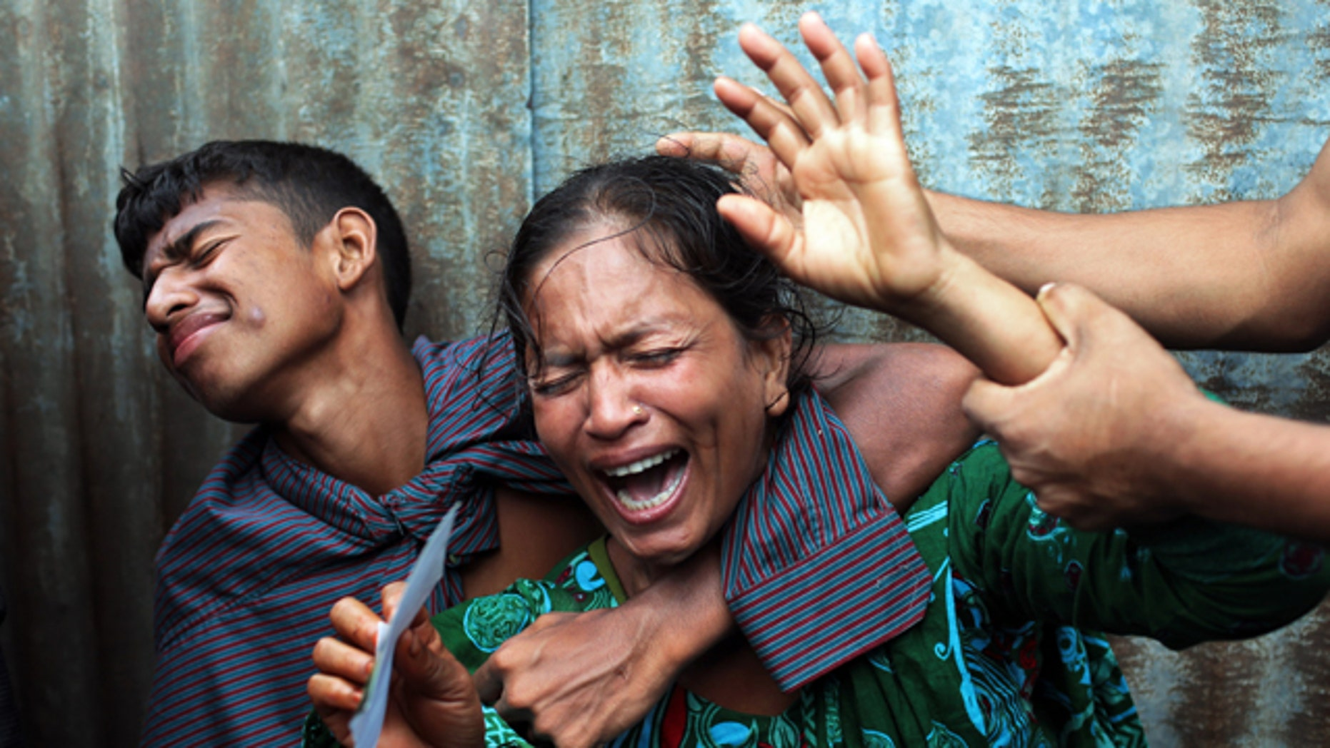 August 4, 2014: Bangladeshi woman Munni, whose daughters are missing, cries as rescuers search the River Padma after a passenger ferry capsized in Munshiganj district. (AP Photo/ A.M. Ahad)