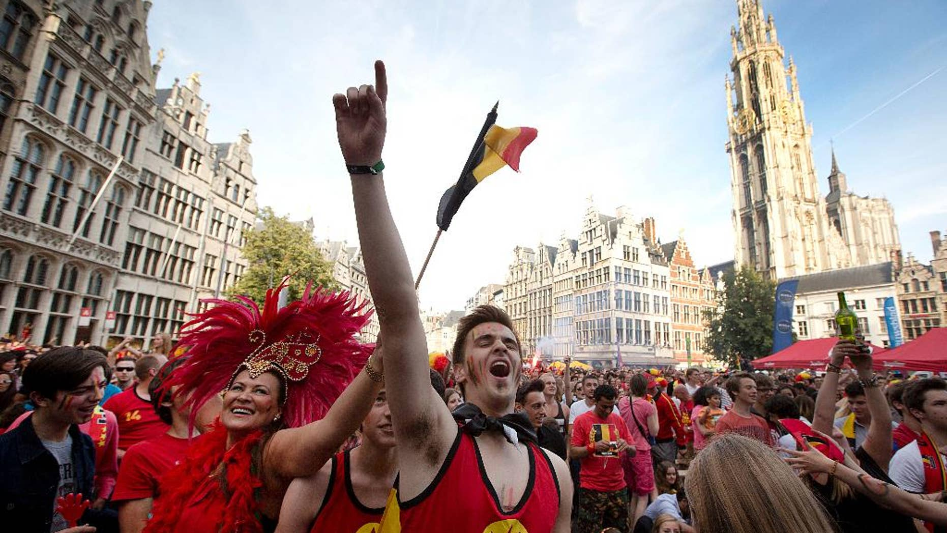 Belgian fans cheer after Belgium scored a goal as they watch the soccer match on a giant screen in the Grote Markt in Antwerp, Belgium on Sunday, June 22, 2014. Belgium scored a 1-0 victory over Russia during the group H World Cup soccer match between Belgium and Russia at the Maracana Stadium in Rio de Janeiro, Brazil. (AP Photo/Virginia Mayo)