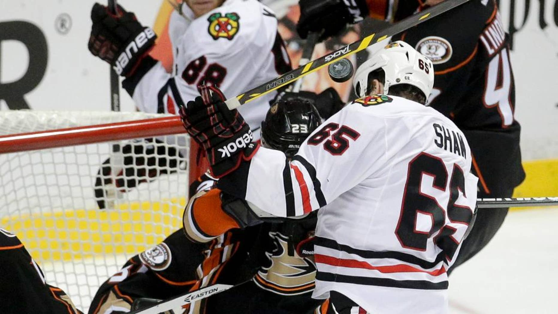 Chicago Blackhawks center Andrew Shaw head-butts the puck into the goal during overtime in Game 2 of the Western Conference final during the NHL hockey Stanley Cup playoffs against the Anaheim Ducks in Anaheim, Calif., on Tuesday, May 19, 2015. The apparent goal was disallowed. (AP Photo/Jae C. Hong)