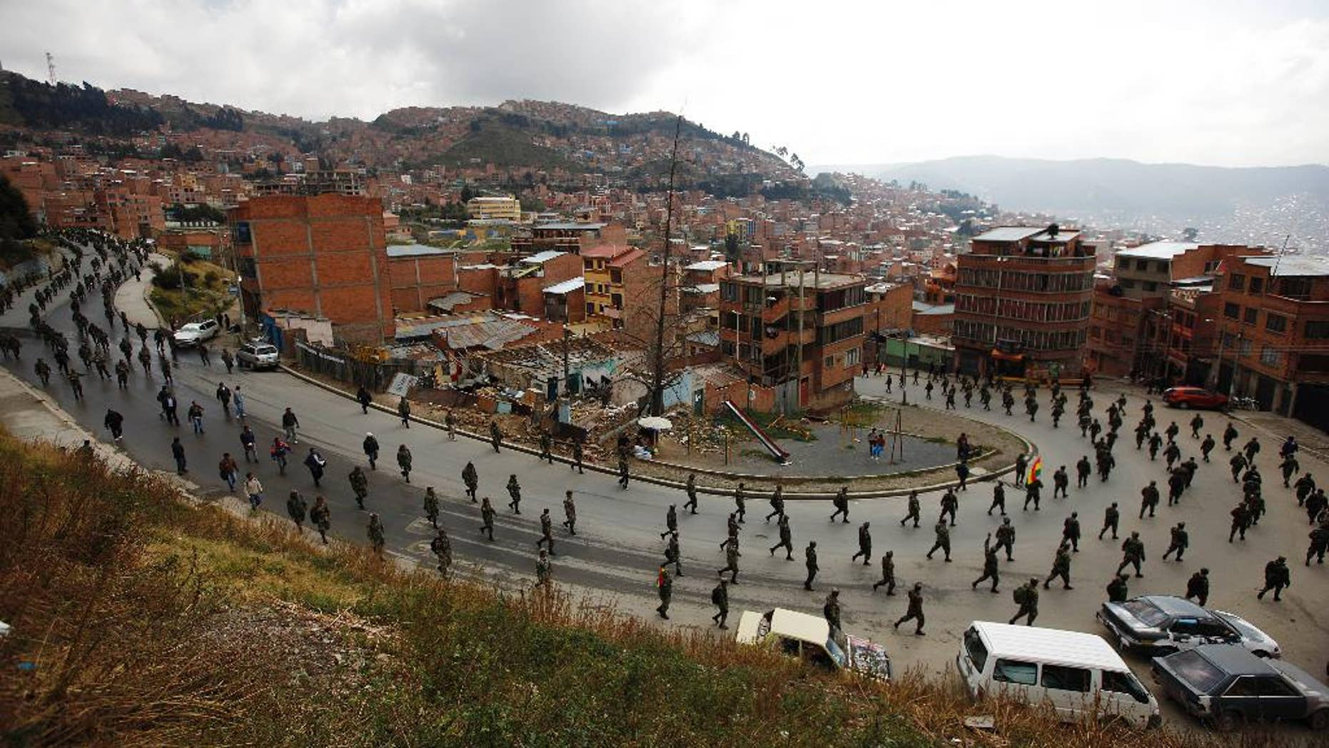 Low ranking soldiers march on the third day of protests in La Paz, Bolivia, Thursday, April 24, 2014. Enlisted soldiers are protesting the military high command's dismissal of four of its leaders who defended their call for changes so that non-commissioned officers may study to become career officers. (AP Photo/Juan Karita)