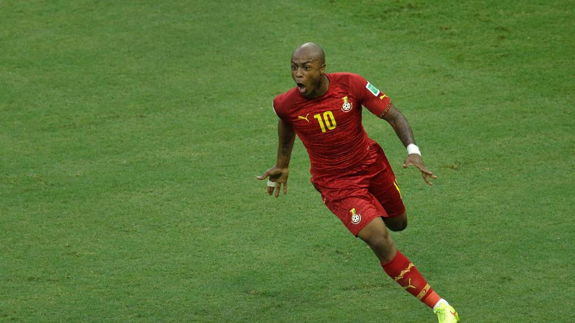 Ghana's Andre Ayew celebrates scoring his side's first goal during the group G World Cup soccer match between Germany and Ghana at the Arena Castelao in Fortaleza, Brazil, Saturday, June 21, 2014. (AP Photo/Themba Hadebe)