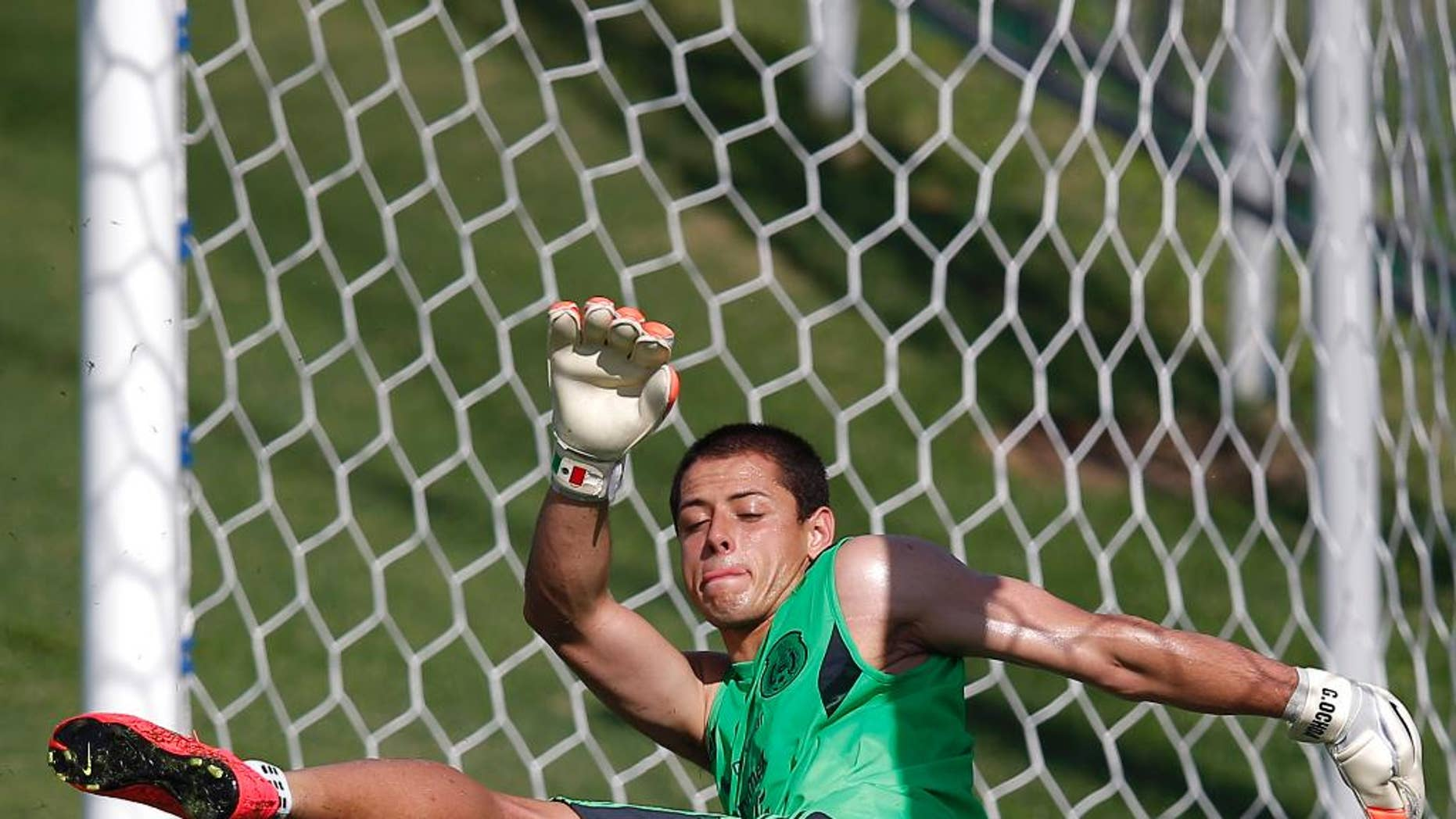 Mexico's national soccer player Javier Hernandez kicks the ball during a training session of Mexico in Santos, Brazil, Sunday, June 8, 2014. Mexico plays in group A of the 2014 soccer World Cup. (AP Photo/Eduardo Verdugo)