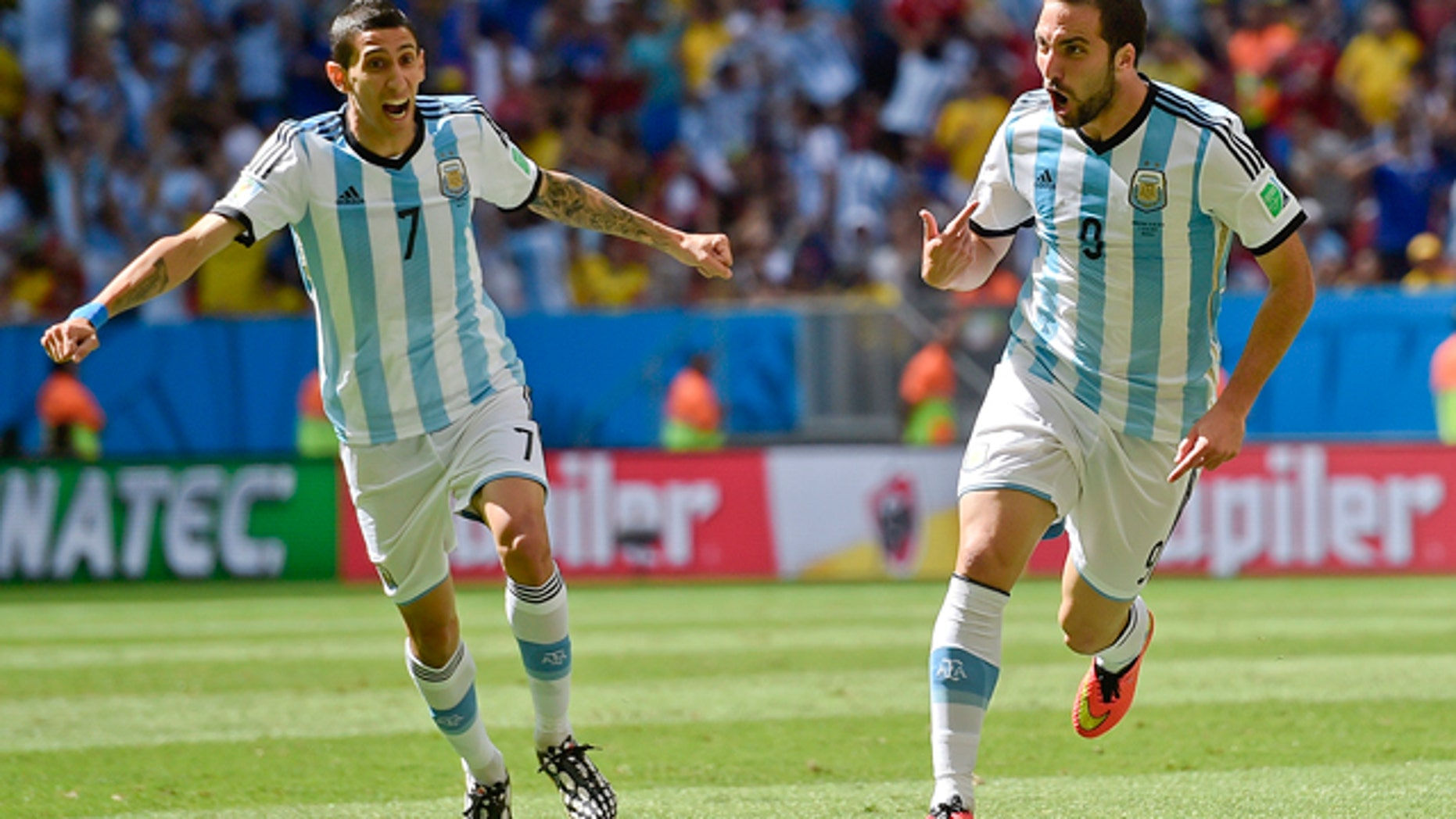 July 5, 2014: Argentina's Gonzalo Higuain, right, celebrates with Angel di Maria after scoring the opening goal during the World Cup quarterfinal soccer match between Argentina and Belgium at the Estadio Nacional in Brasilia, Brazil. (AP Photo/Martin Meissner)