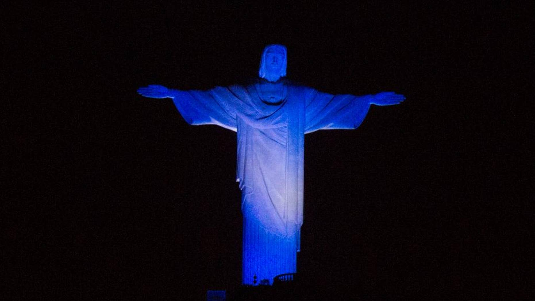 Christ the Redeemer statue is lit with the Argentina team's colors as part of soccer the World Cup, in Rio de Janeiro, Brazil, Saturday, July 12, 2014. Argentina will face Germany for the final match of the world tournament. (AP Photo/Leo Correa)