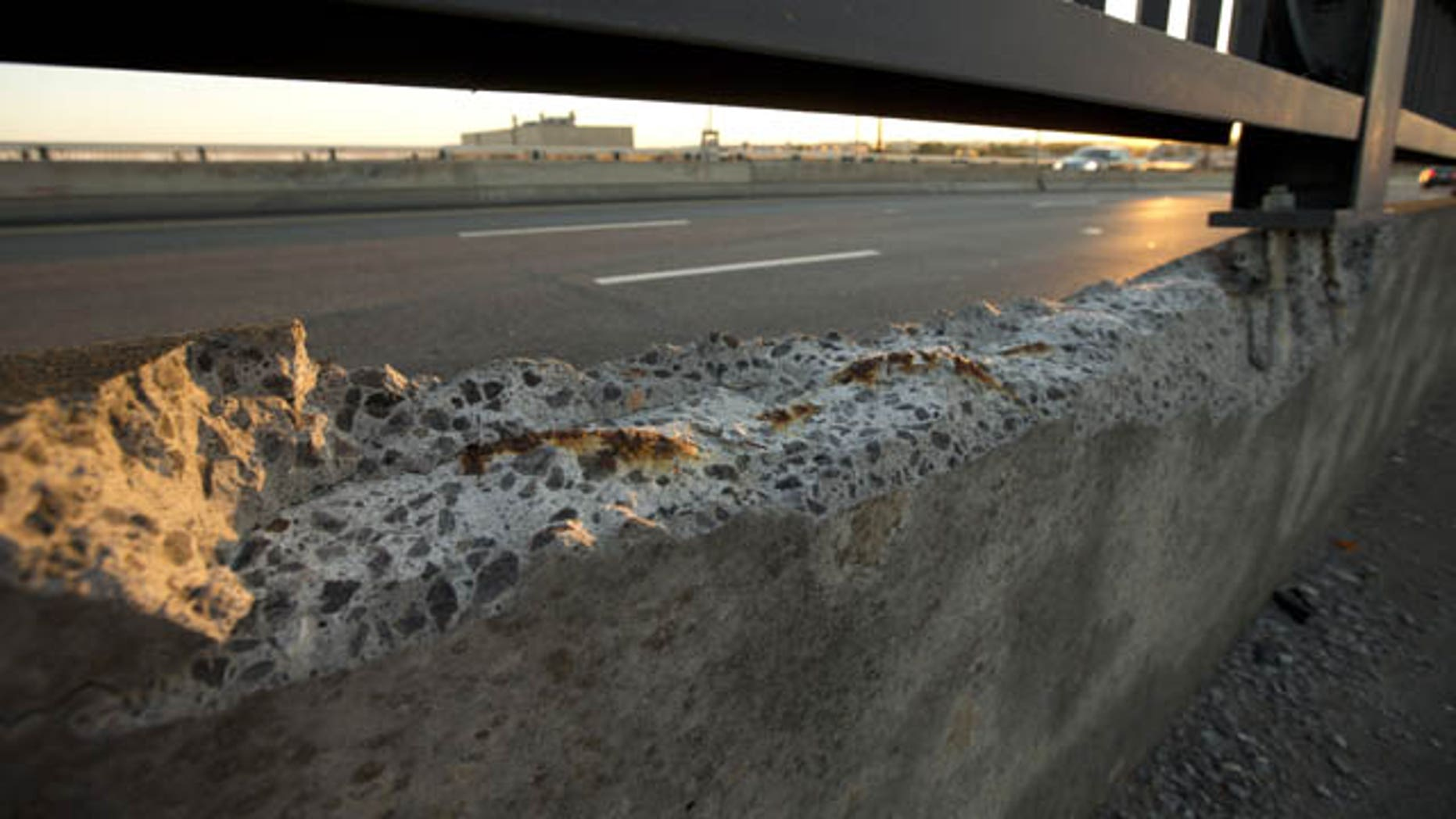 September 4, 2013: Cracked concrete exposes parts of reinforcement bars on the Frederick Douglass Memorial Bridge which spans the Anacostia River in Washington.