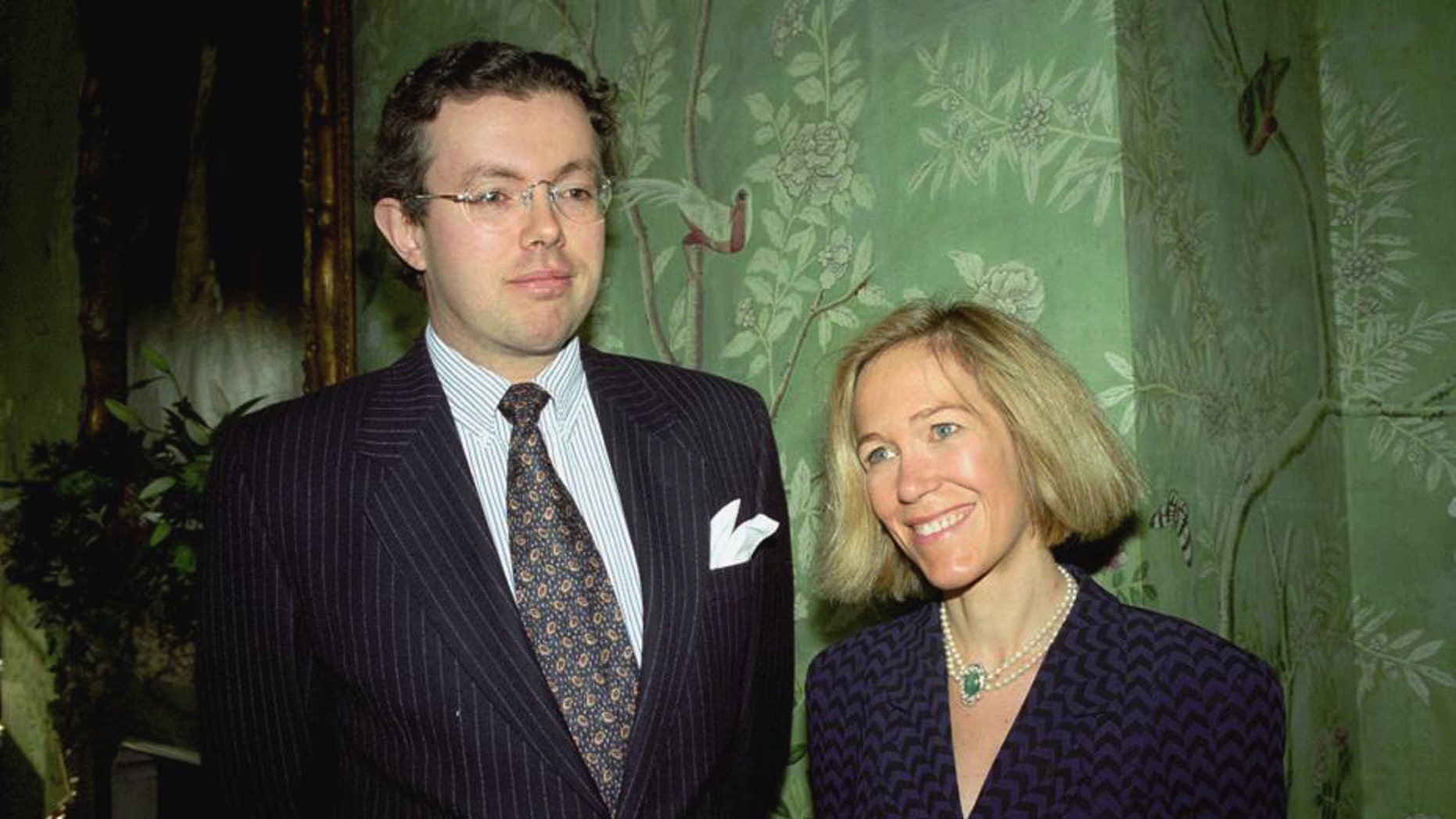 This photo of Nov. 26, 1996 shows Eva Rausing, right, and her husband Hans Kristian Rausing at Winfield House, London, the residence of the US ambassador to the UK attending the Glamour America Fashion Show and lunch. One of Britain's richest women, American-born Eva Rausing, was found dead in her west London home and a man was arrested in connection with the case, British police say, adding that an autopsy had failed to uncover a formal cause of death. Rausing, 48, was the wife of Hans Kristian Rausing, heir to the TetraPak fortune his father built by creating a successful manufacturer of laminated cardboard drink containers.  (AP Photo/Alan Davidson/The Picture Library Ltd)