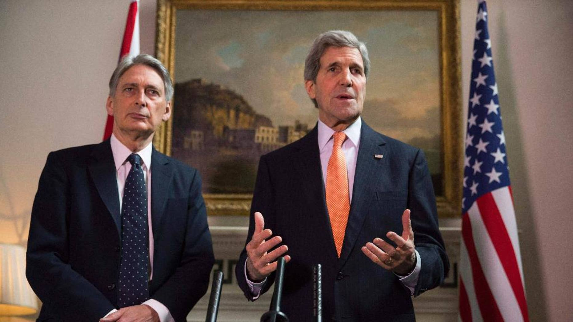 "Britain's Foreign Secretary Philip Hammond and U.S. Secretary of State John Kerry, right, deliver a statement at a press conference in London, Saturday Feb, 21, 2015.  US Secretary of State John Kerry, in London for talks with Foreign Secretary Philip Hammond, said Russia's conduct was ""simply unacceptable"" and that he expected to see agreement on further international sanctions in the coming days. ""Russia has engaged in an absolutely brazen and cynical process over these last days. We know to a certainty what Russia has been providing to the separatists, how Russia is involved with the separatists,"" he told reporters. (AP Phto/Neil Hall/Pool)"