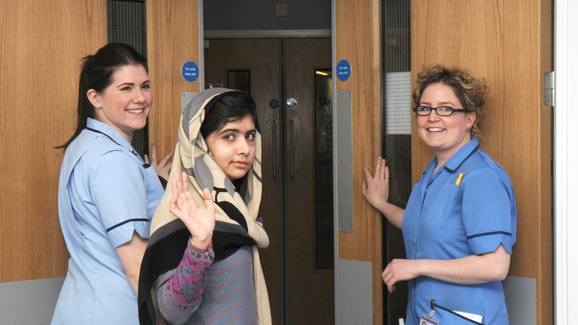 Jan. 4, 2013 - This photo made available by Queen Elizabeth Hospital, Birmingham, England shows Malala Yousufzai saying goodbye as she is discharged from the hospital.