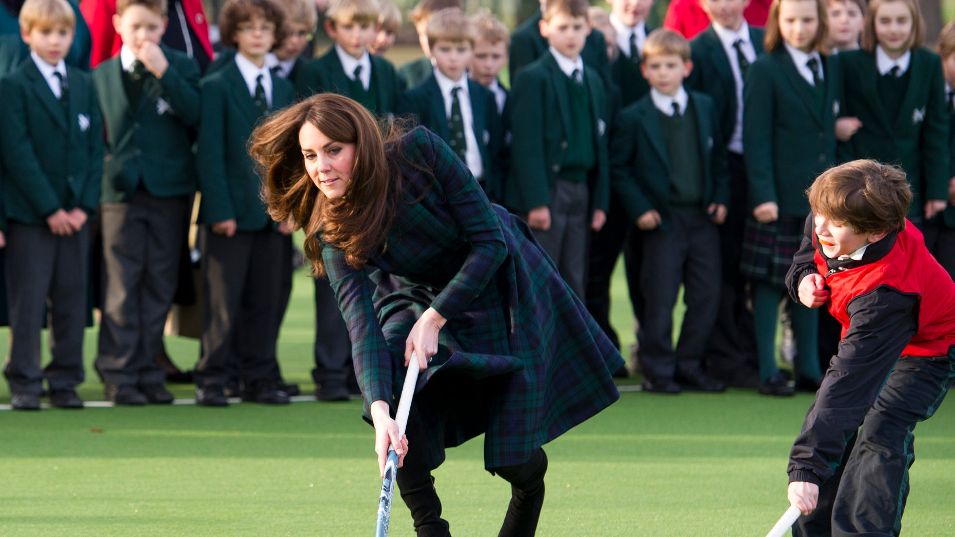 Nov. 30, 2012 - Kate, the Duchess of Cambridge plays hockey during her visit to St. Andrews School in Pangbourne, England.