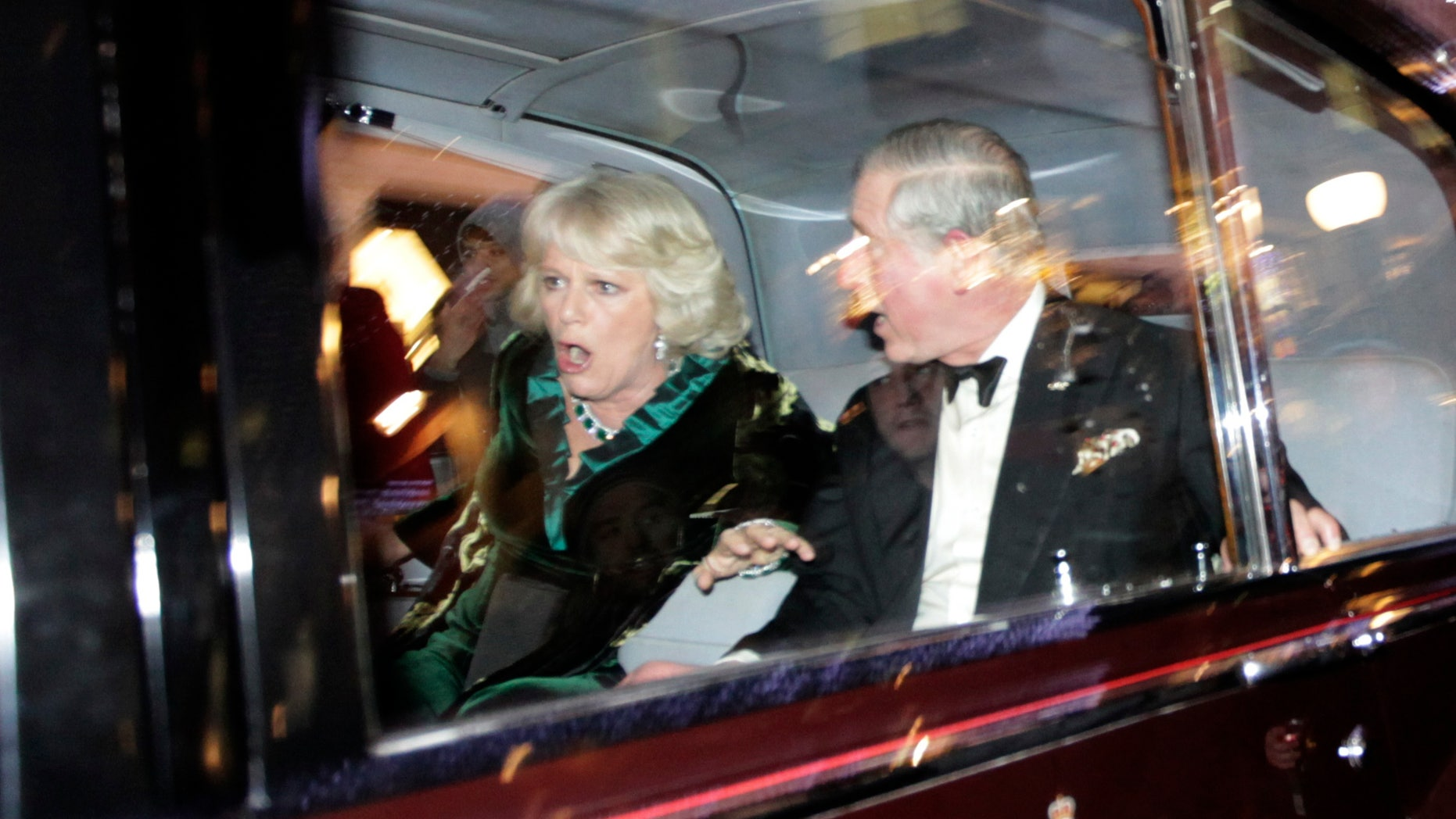 Dec. 9: Britain's Prince Charles and Camilla, Duchess of Cornwall, react as their car is attacked by angry protesters in London.