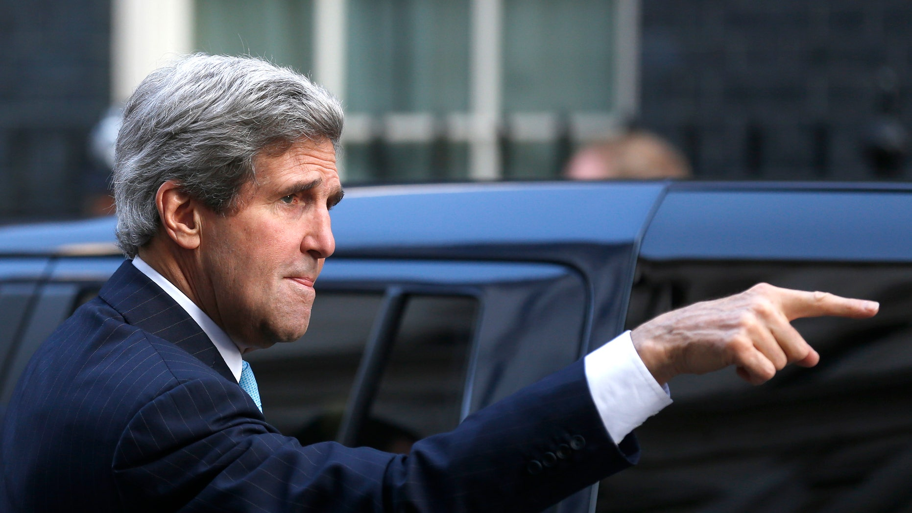US Secretary of State John Kerry gestures as he arrives for a meeting with Britain's Prime Minister David Cameron and the Foreign Secretary William Hague at Downing street in London, Friday, March, 14, 2014. Kerry arrived in London Friday, for his last meeting with Russian Foreign Minister Sergey Lavrov before the Crimea vote. (AP Photo/Sang Tan)