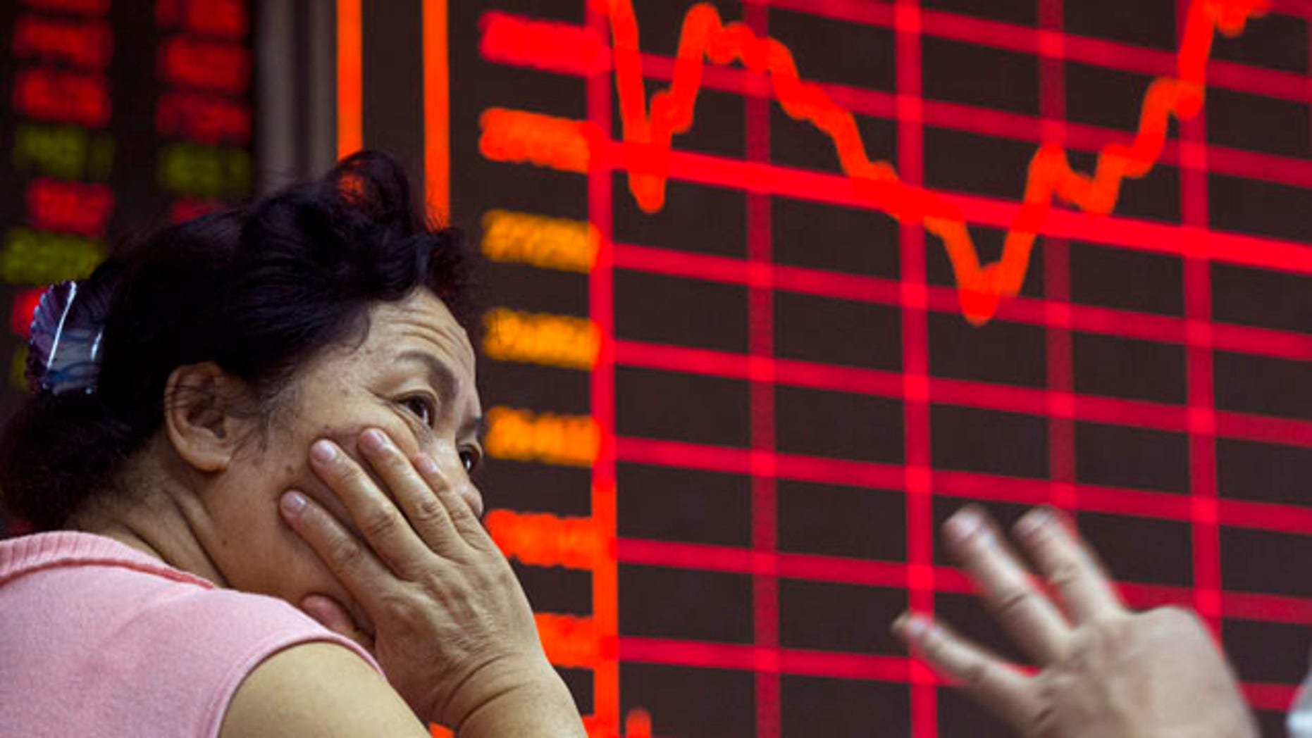 Aug. 26, 2015: A Chinese investor monitors stock prices at a brokerage in Beijing. (AP Photo/Ng Han Guan)