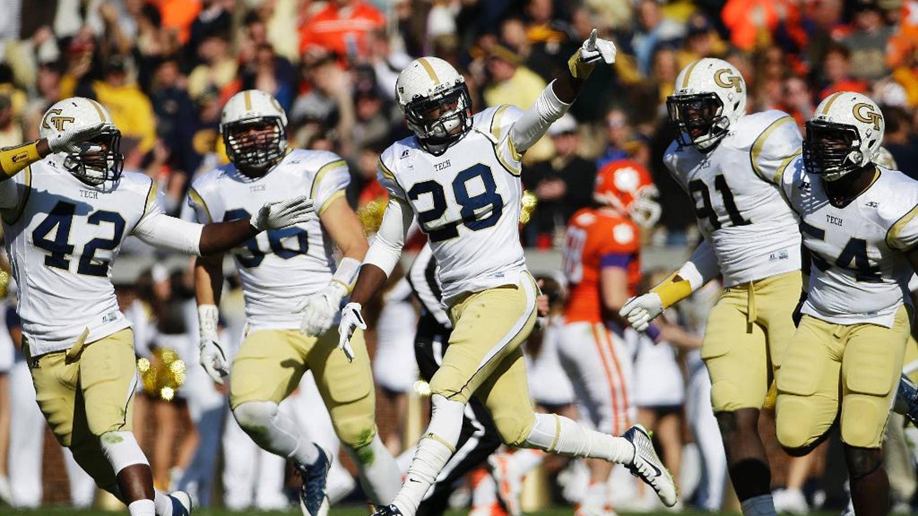 Georgia Tech's D.J. White, center, celebrates after intercepting a pass in the third quarter of an NCAA college football game against Clemson, Saturday, Nov. 15, 2014, in Atlanta. Georgia Tech won 28-6. (AP Photo/David Goldman)
