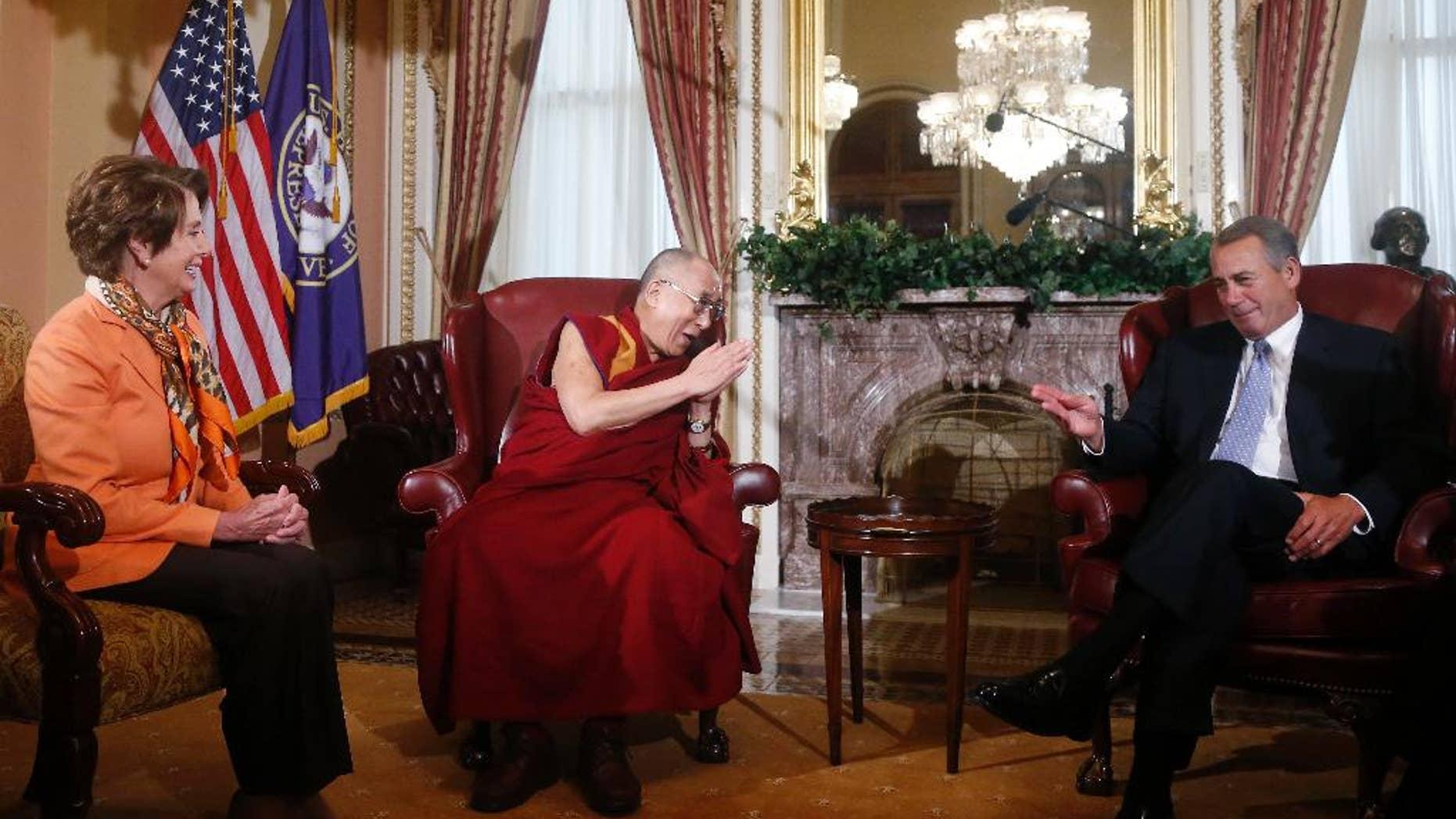Tibetan spiritual leader the Dalai Lama meets with House Speaker John Boehner of Ohio and House Minority Leader Nancy Pelosi of Calif., on Capitol Hill in Washington, Thursday, March 6, 2014. (AP Photo/Charles Dharapak)