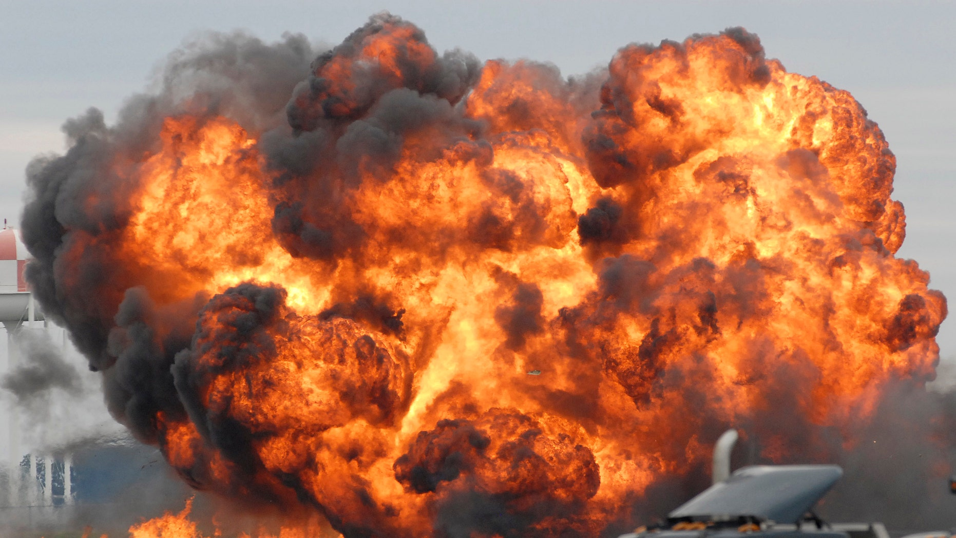 A single engine T-28 from the six-plane Trojan Horsemen Demonstration Flight Team crashes and explodes during a performance at the Thunder Over the Blue Ridge Open House and Air Show, Saturday, Sept. 17, 2011 at the 167th Airlift Wing in Martinsburg, W.Va.