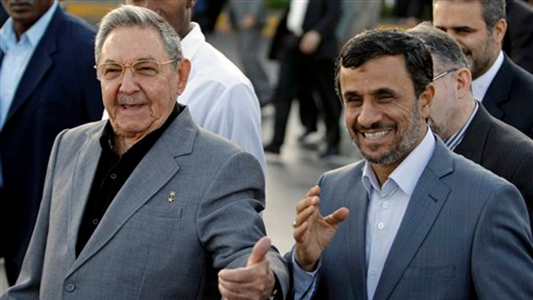 Jan. 12: Cuba's President Raul Castro, left, and  Iran's President Mahmoud Ahmadinejad gesture before Ahmadinejad's departure at the Jose Marti international airport in Havana, Cuba.