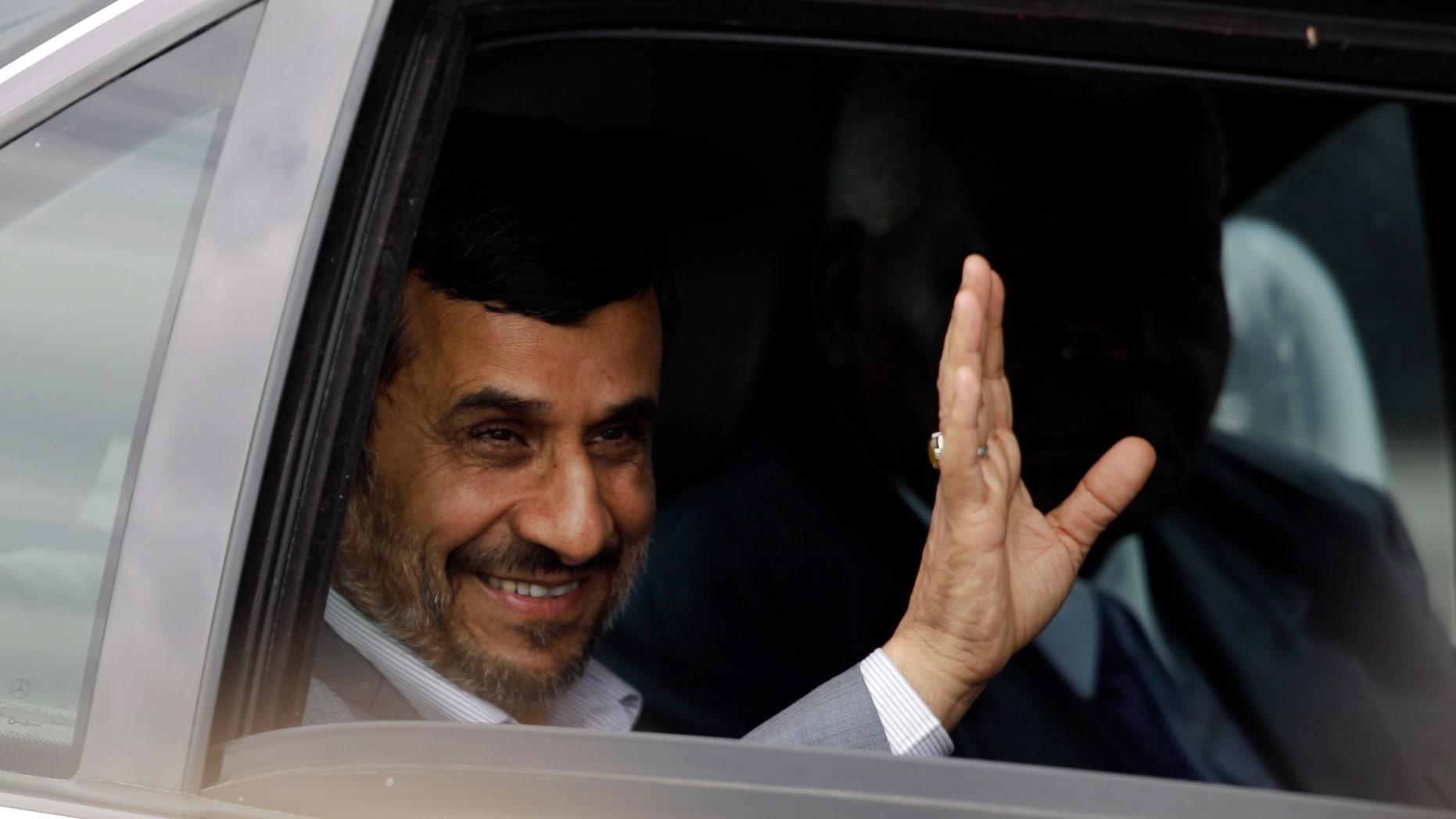 Jan. 11, 2012: Iran's President Mahmoud Ahmadinejad waves from a car after arriving to Jose Marti international airport in Havana, Cuba.