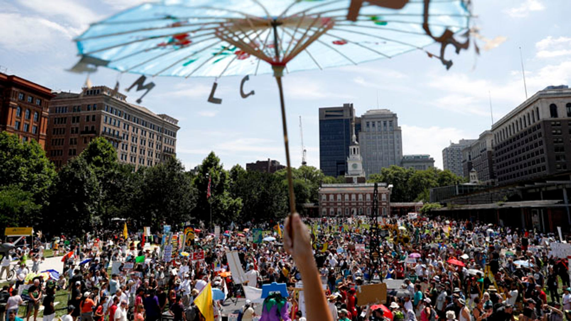 Protesters gather during a demonstration at Liberty Square on Sunday, July 24, 2016, in Philadelphia.