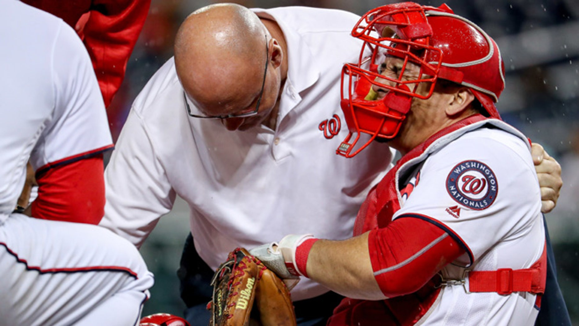 Washington Nationals catcher Wilson Ramos (40) goes down with a knee injury during the 6th inning of a baseball game at Nationals Park in Washington, Monday, Sept. 26, 2016. (AP Photo/Andrew Harnik)