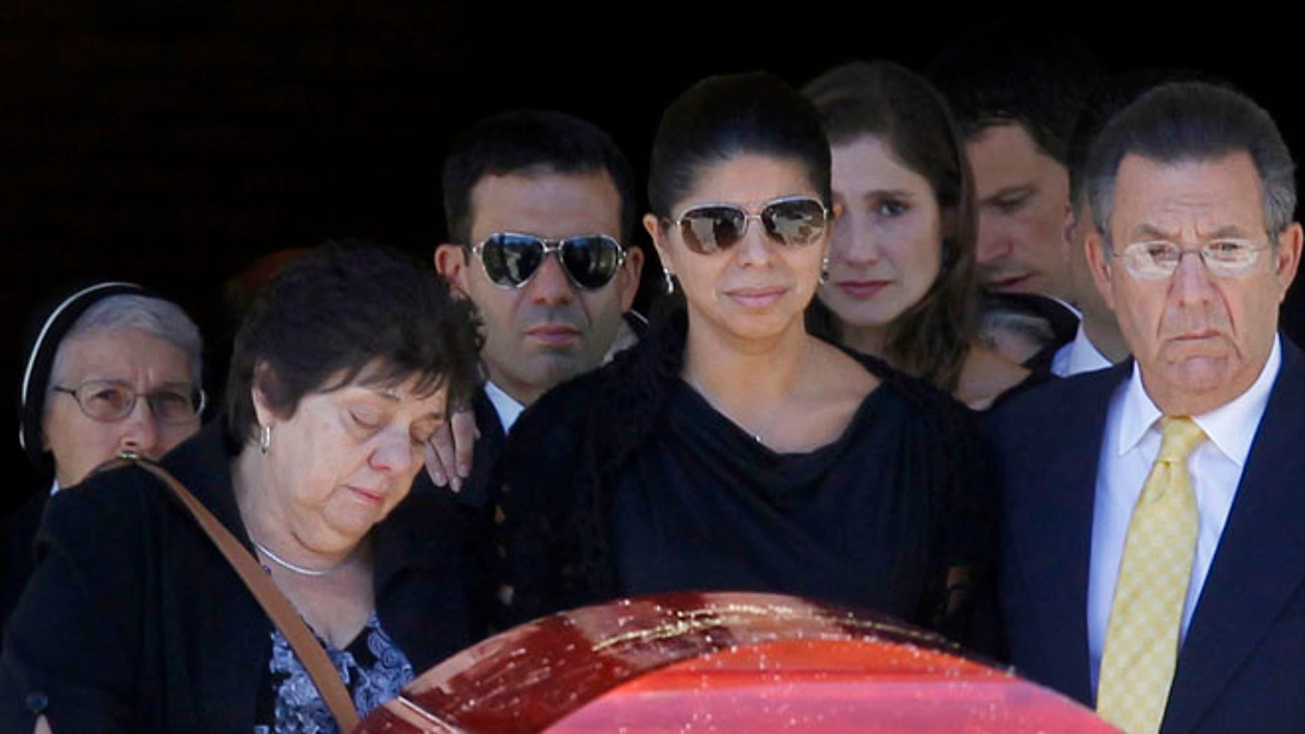 Aug. 29, 2012: Ivette Rivera, center, fiancee of Empire State Building shooting victim Steve Ercolino, is flanked by the victim's parents, Rosalie and Frank Ercolino, as they follow the coffin out after a funeral mass at Our Lady of Sorrows church in White Plains, N.Y.