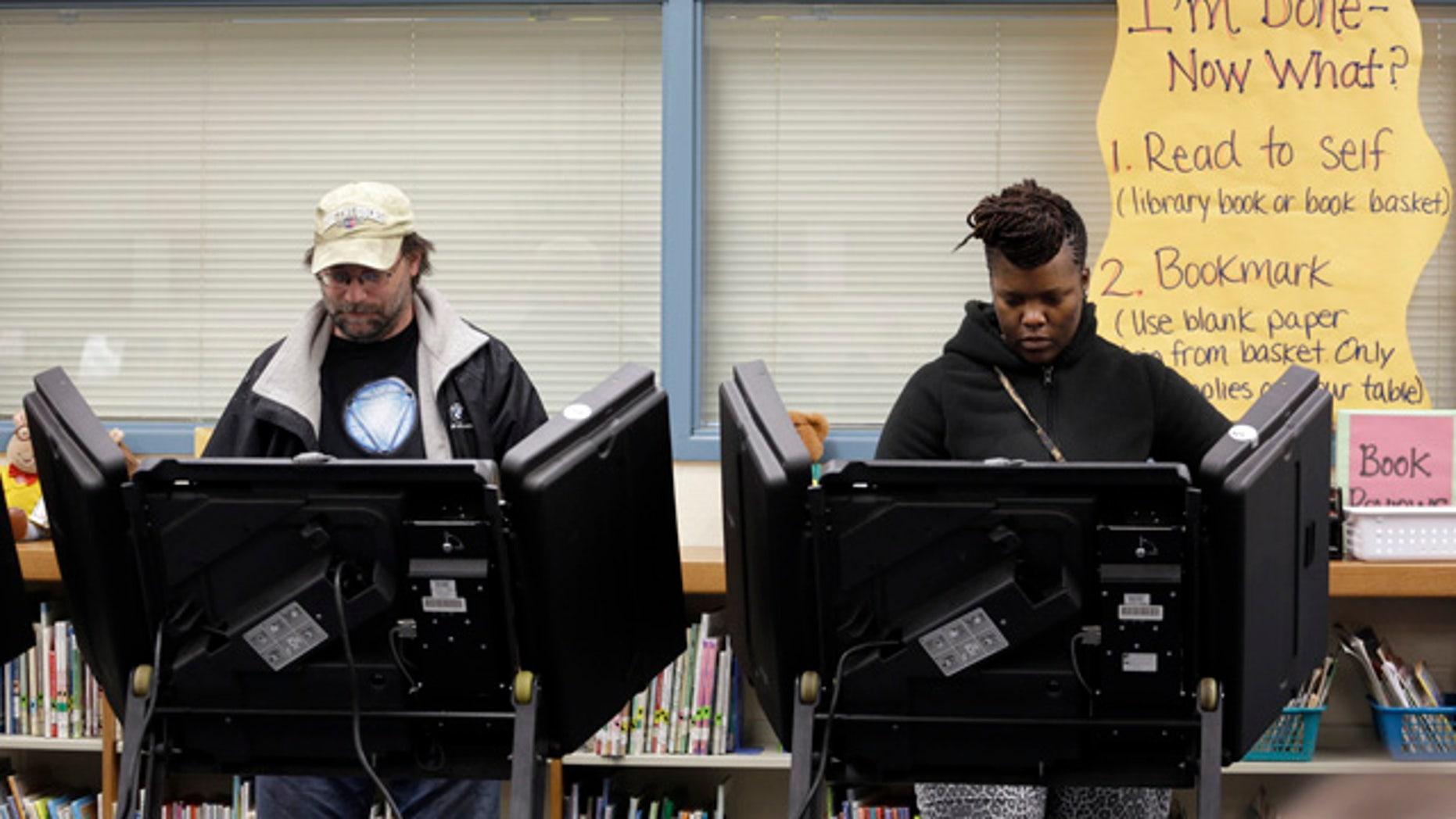 April 7, 2015: Rich Baranowski, left, and Tracy Hardy vote in Ferguson's municipal election, in Ferguson, Mo. (AP Photo/Jeff Roberson)