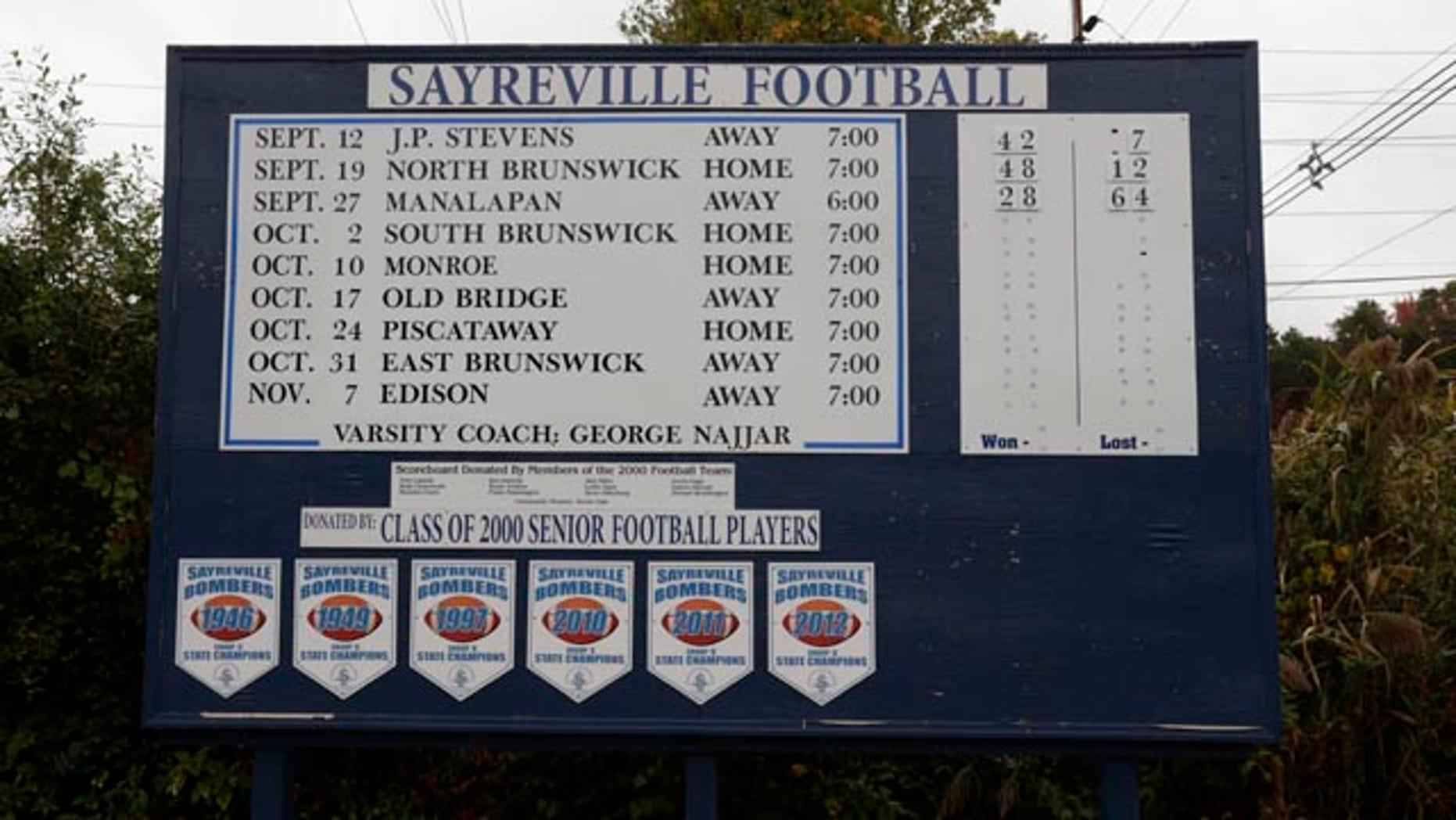October 11, 2014: A roadside sign displays the Sayreville War Memorial High School football team schedule on Main Street in Sayreville, N.J. (AP Photo/Julio Cortez)