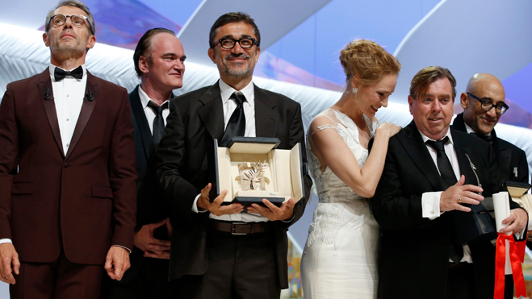 May 24, 2014: Director Nuri Bilge Ceylan, center, poses with the Palme d'Or award for the film Winter Sleep and actor Timothy Spall, second right, poses with his award for Best Actor for his role in the film Mr. Turner during the awards ceremony for the 67th international film festival, Cannes, southern France. (AP)