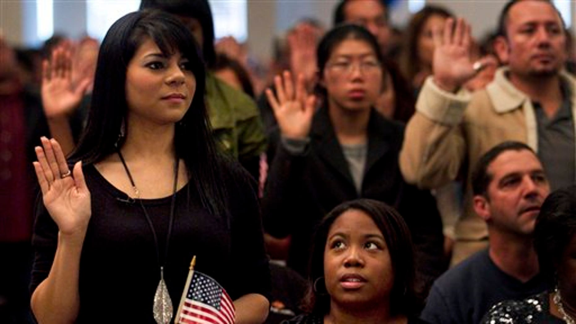 Dec. 15: Shyima Hall, left, takes the oath of citizenship during a citizenship ceremony in Montebello, Calif.