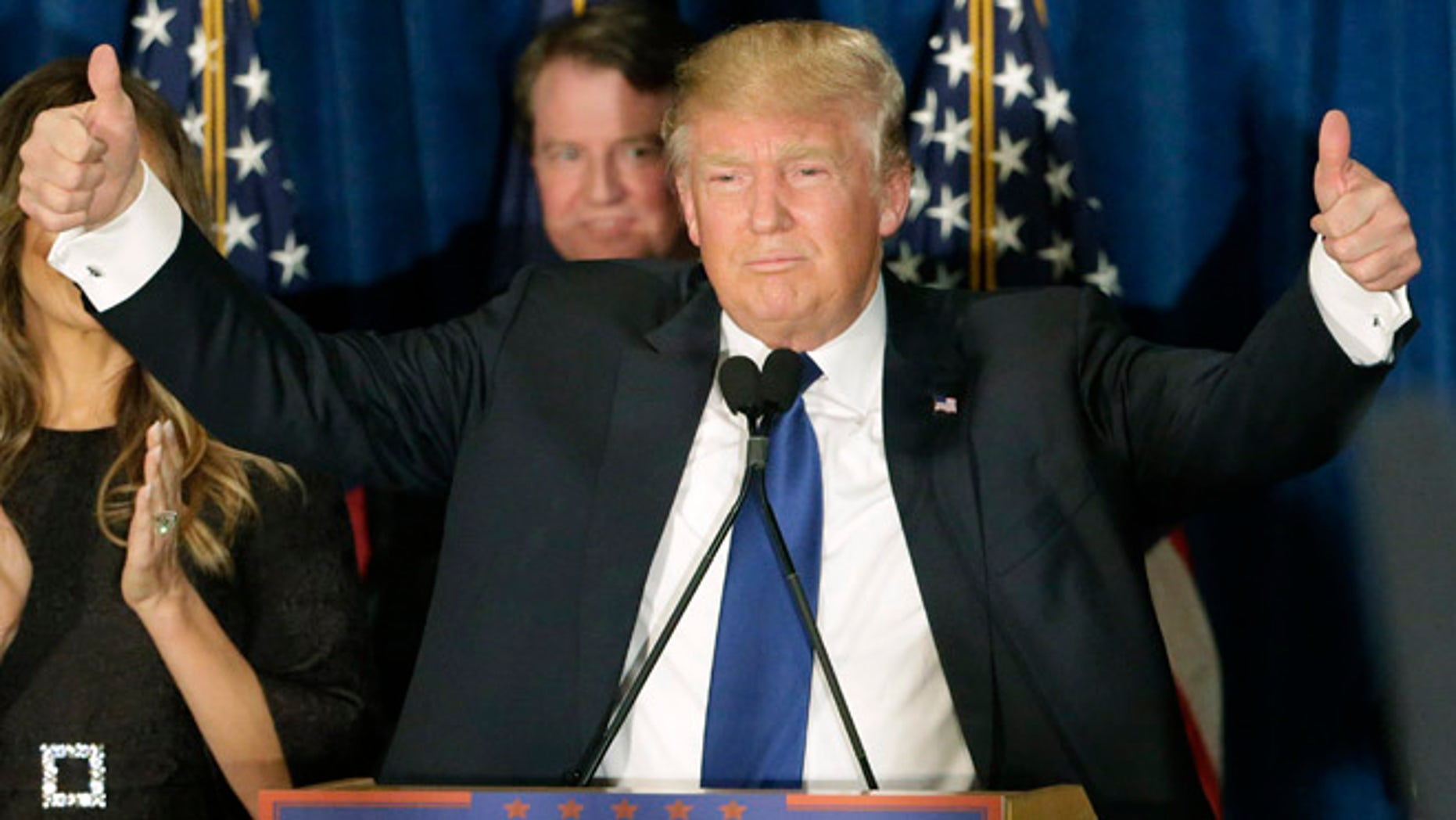Donald Trump gives thumbs up to supporters during a primary night rally, Tuesday, Feb. 9, 2016, in Manchester, N.H.