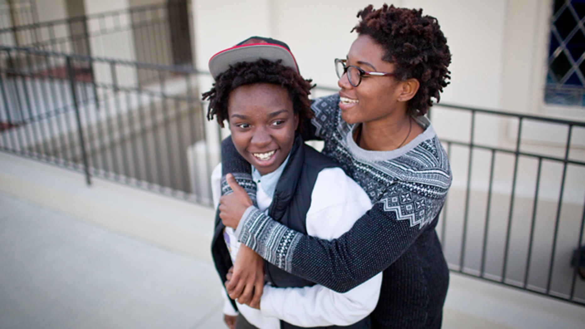 Jan. 25, 2015: Shanté Wolfe, left and Tori Sisson embrace near the Montgomery County Courthouse, where they plan to stay overnight to be married Monday morning. A federal judge has stayed her order overturning Alabama's gay marriage ban for two weeks. (AP Photo/Brynn Anderson)