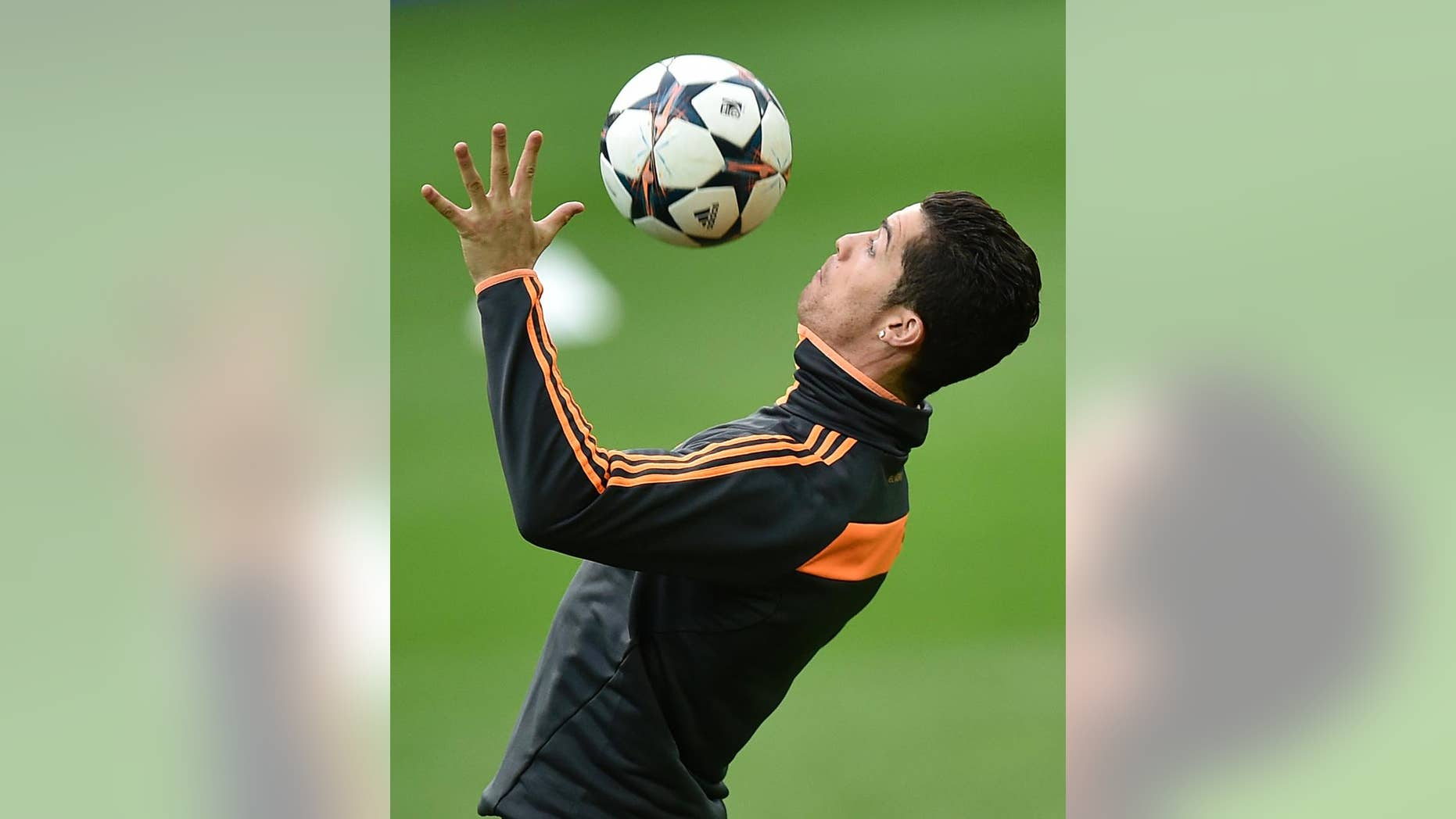 Real's Cristiano Ronaldo controls the ball during a training session prior the UEFA Champions League second leg soccer match between Borussia Dortmund and Real Madrid in Dortmund, Monday, April 7, 2014. Ronaldo had to break off the training. (AP Photo/Martin Meissner)