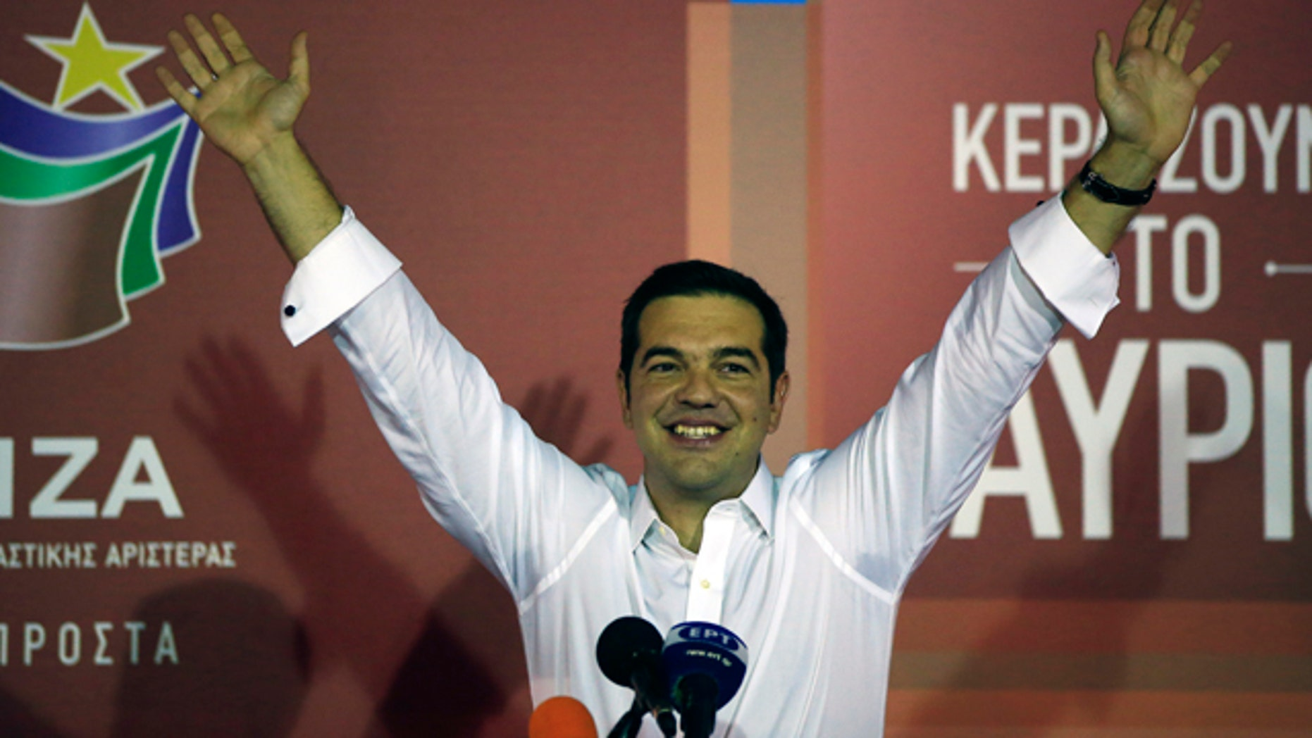 Sept. 20, 2015: Alexis Tsipras the leader of left-wing Syriza party waves to his supporters after the election results at the party's main electoral center in Athens. (AP Photo/Lefteris Pitarakis)