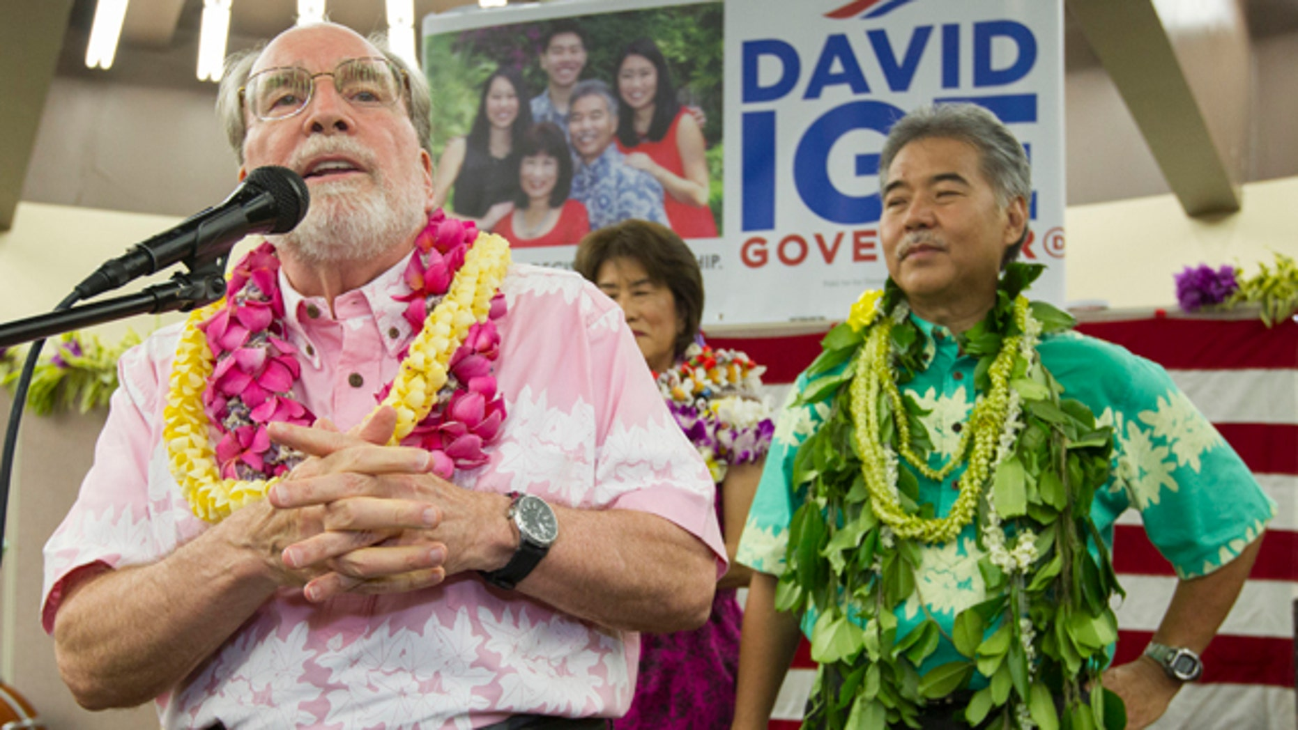 Saturday 9, 2014: Hawaii Governor Neil Abercrombie, left, addresses the supporters of Hawaii State Sen. David Ige as Ige, right, looks on. Ige defeated Abercrombie in the state's primary election to win the Democratic Party's nomination. (AP Photo/Eugene Tanner)