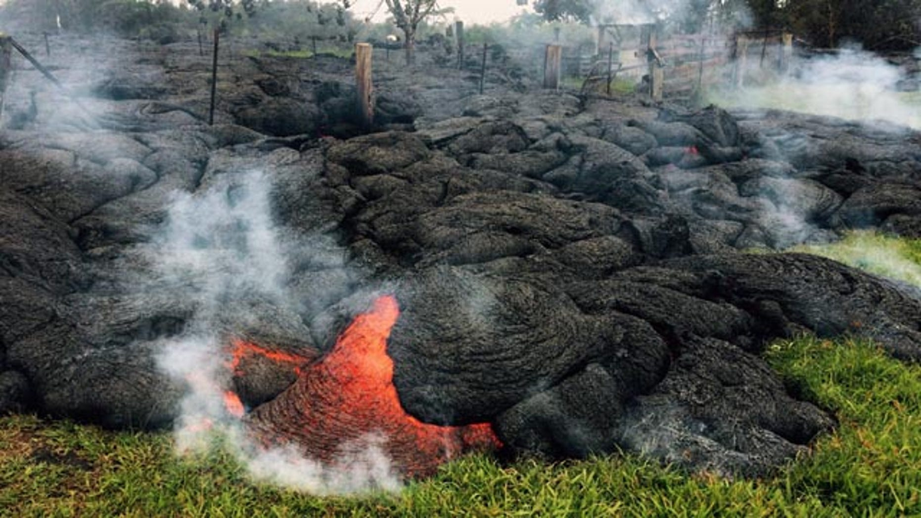 October 26, 2014: This photo provided by the U.S. Geological Survey shows the lava flow from an eruption that began on June 27, as the front remains active and continues to advance towards the northeast, threatening the town of Pahoa on the Big Island of Hawaii. (AP Photo/U.S. Geological Survey)