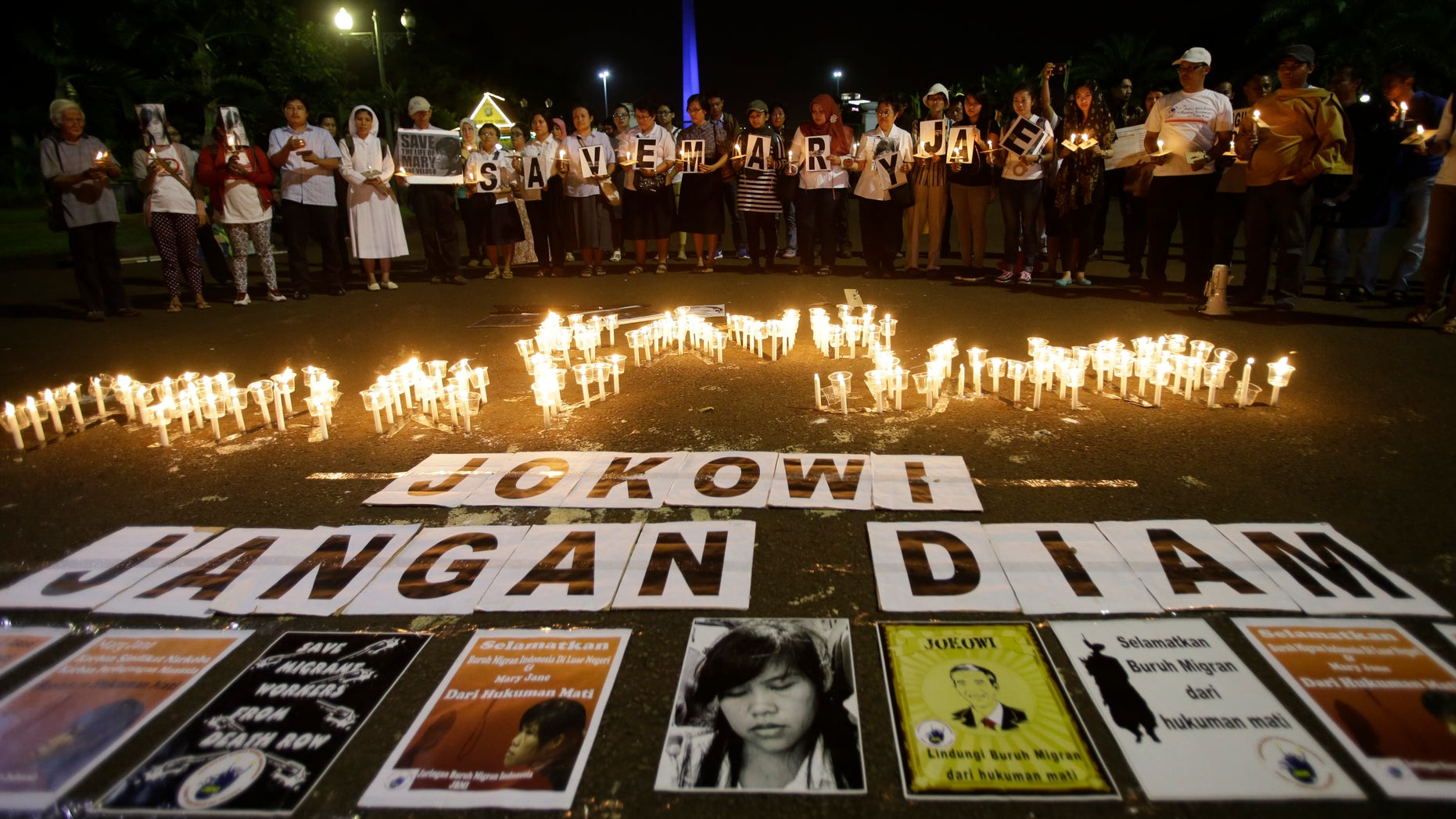 "April 27, 2015 - Indonesian protesters gather with candles and banners that read "" Save the Mary Jane, Jokowi (President Joko Widodo), Don't be silent"" during a demonstration to demand the government to stop the execution of convicted Filipino Mary Jane Veloso, in Jakarta, Indonesia."