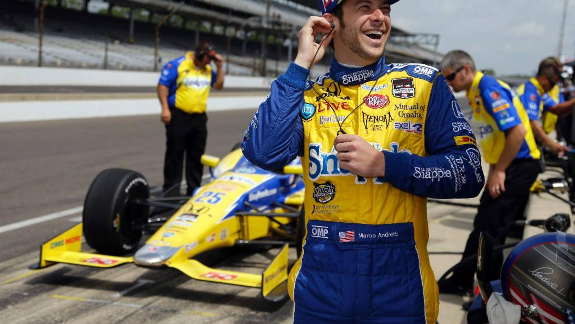 Marco Andretti laughs as he waits for the track to open during practice for the Indianapolis 500 IndyCar auto race at the Indianapolis Motor Speedway in Indianapolis, Monday, May 12, 2014. (AP Photo)