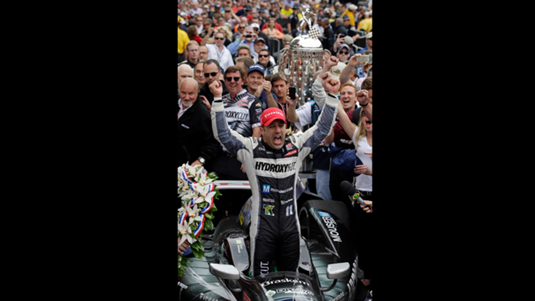 May 26, 2013: Tony Kanaan, of Brazil, celebrates after winning the Indianapolis 500 auto race at the Indianapolis Motor Speedway in Indianapolis.