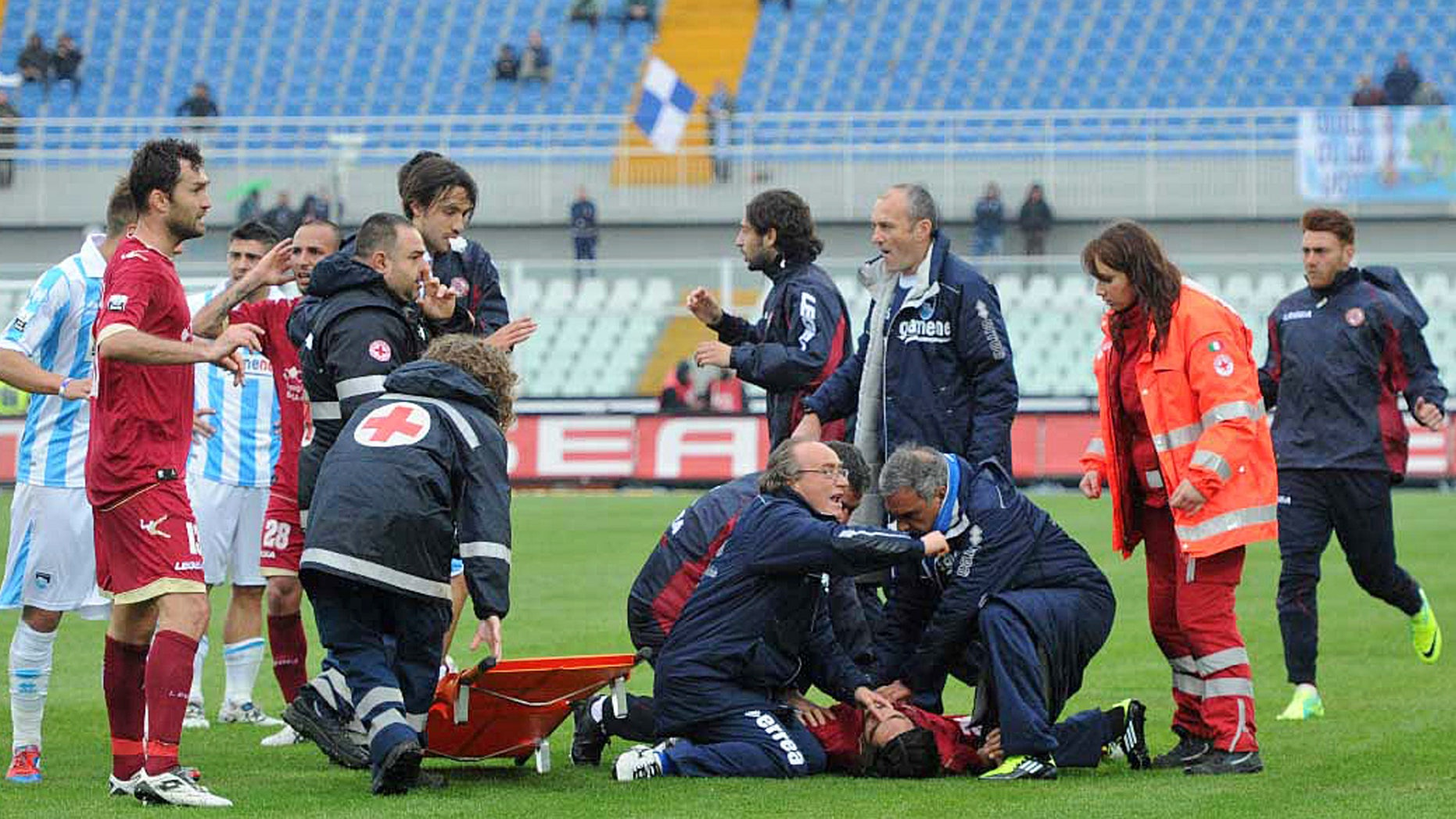 April 14, 2012: Medics assists Livorno's Piermario Morosini laying on the turf of the Pescara's Adriatico stadium, central Italy, Saturday, after he collapsed during a Serie B soccer match between Pescara and Livorno.