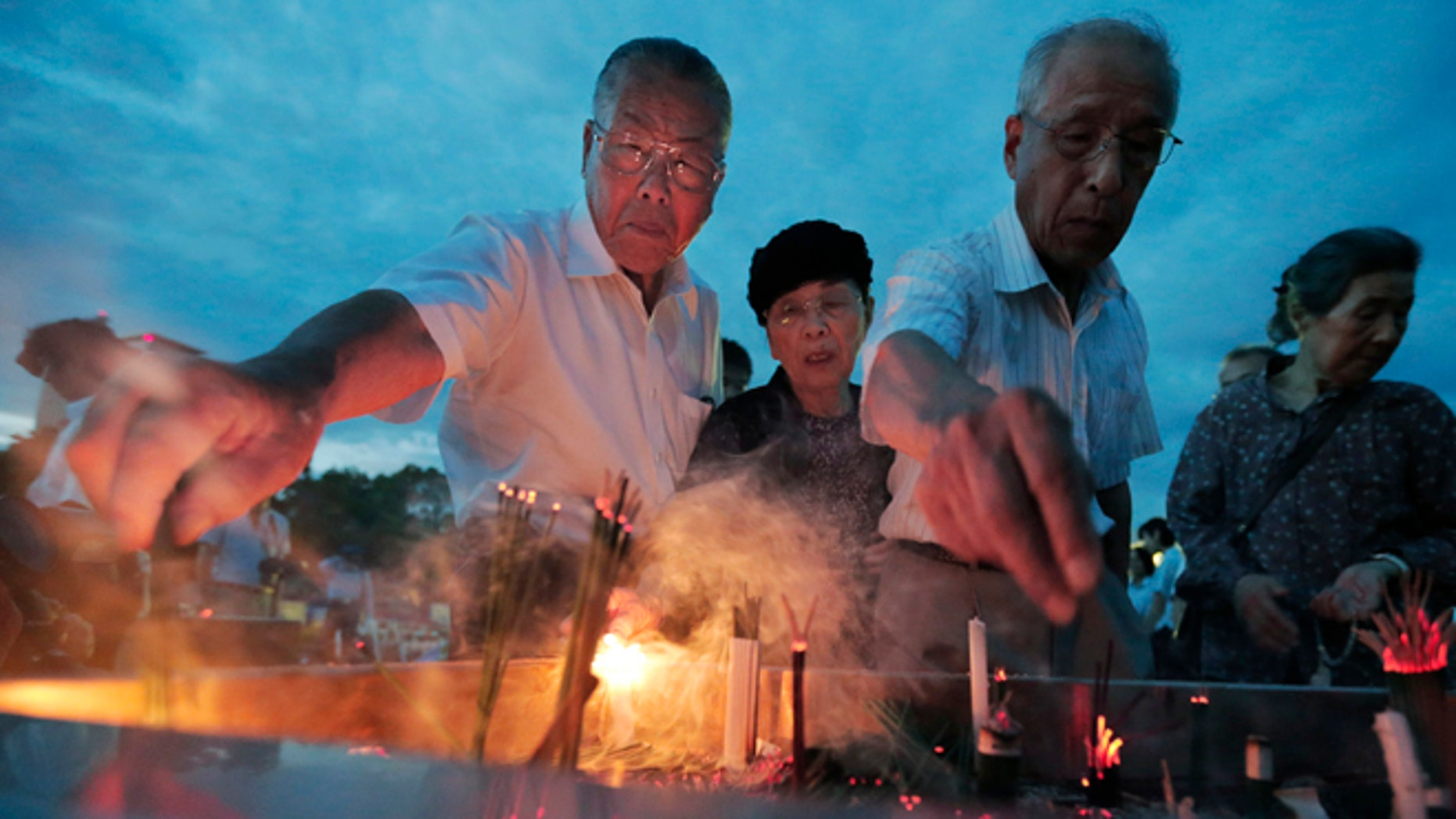 Aug. 6, 2012: People burn incenses and pray in front of the cenotaph dedicated to the victims of the atomic bombing at the Peace Memorial Park as they mark the 67th anniversary of the world's first atomic bombing, in Hiroshima, western Japan.