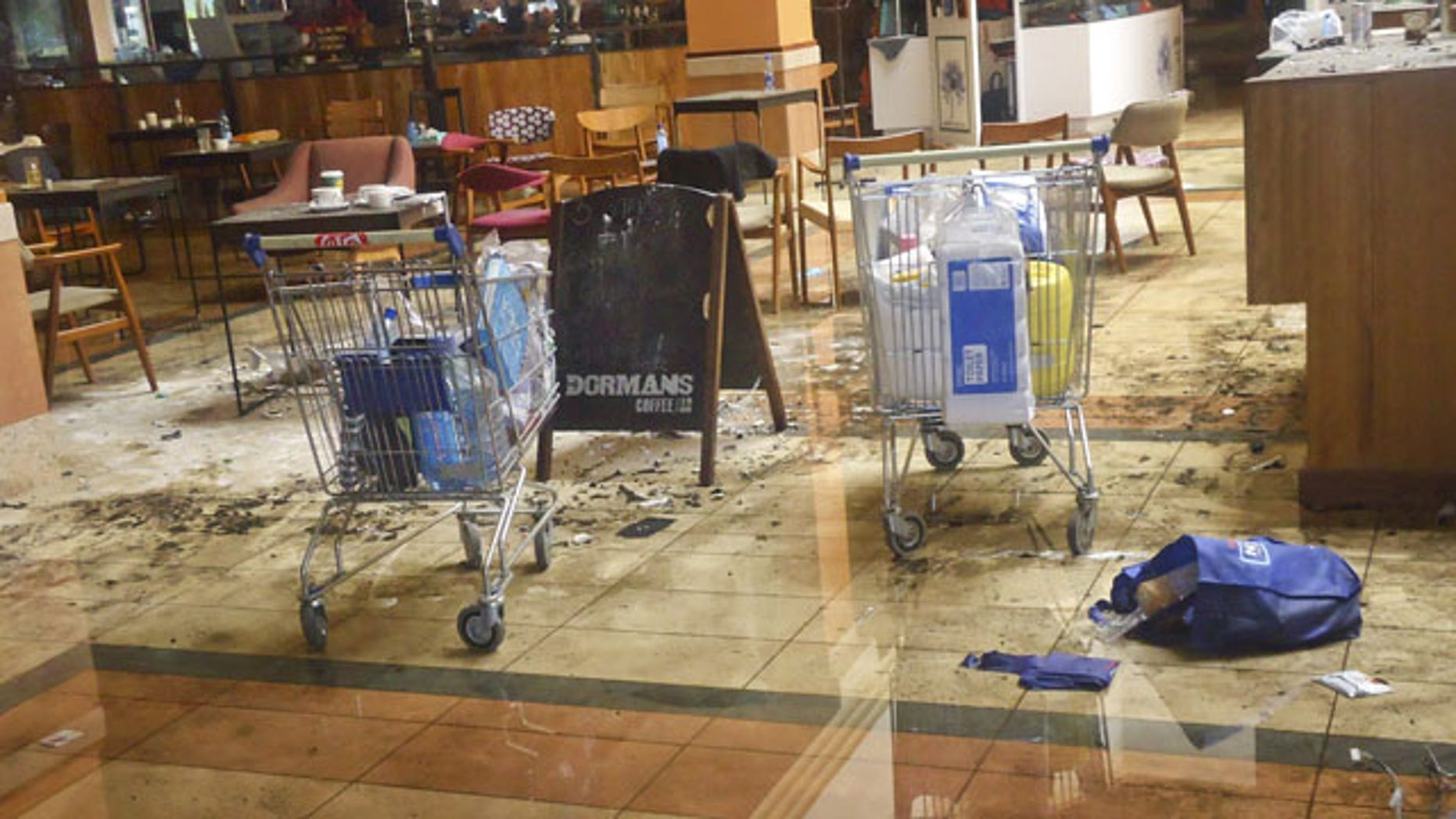 September 30, 2013: This photo taken Friday, Sept. 27, 2013 shows the scene at the Dormans coffee shop on the ground floor of the Westgate Mall in Nairobi, Kenya. (AP Photo)