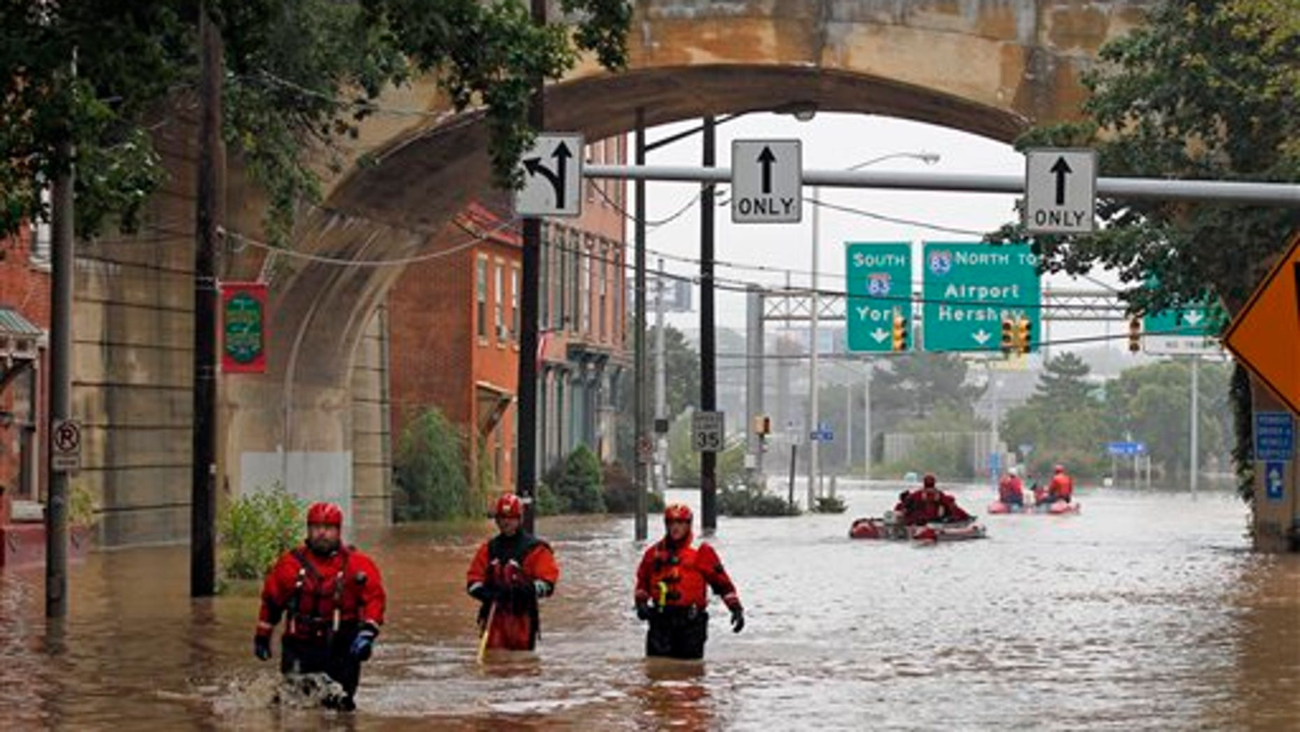 Sept. 9: Members of the Harrisburg River Rescue unit walk out of the water after launching a boat to take Mayor Linda Thompson to the flooded Shipoke area during flooding caused by rainfall from the remnants of Tropical Storm Lee, in Harrisburg, Pa.