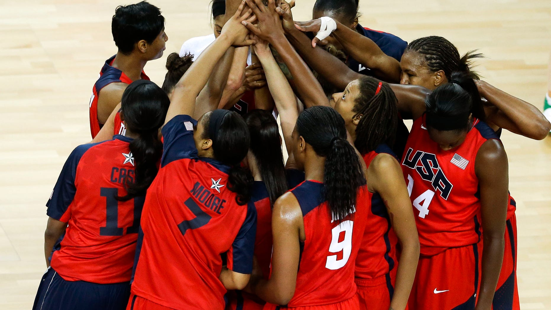 The United States team gathers at half court after beating Australia in a women's basketball semifinal game at the 2012 Summer Olympics, Thursday, Aug. 9, 2012, in London. (AP Photo/Victor R. Caivano)