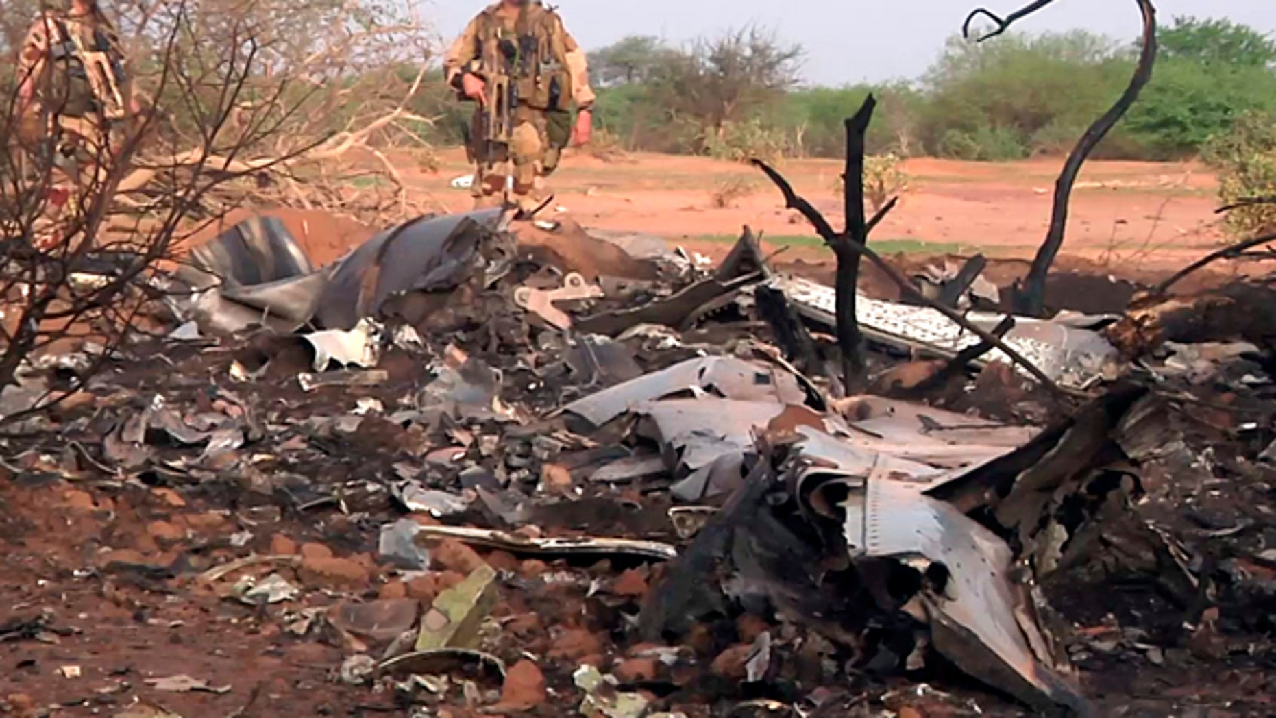 July 25, 2014: This photo provided by the French army shows soldiers at the site of the plane crash in Mali.  (AP Photo/ECPAD)