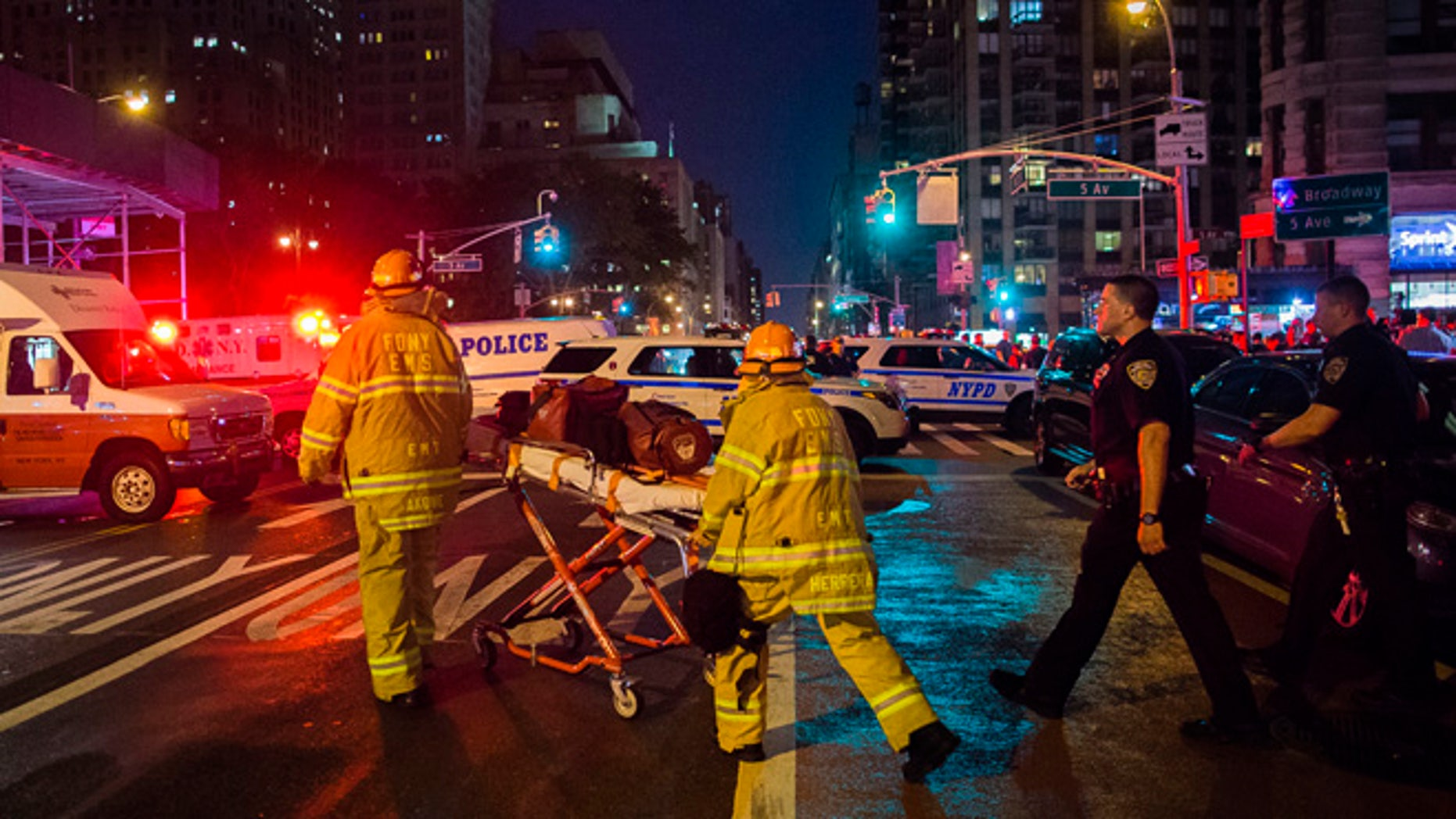Police and firefighters work near the scene of an apparent explosion in Manhattan's Chelsea neighborhood, in New York, Saturday, Sept. 17, 2016. A law enforcement official tells The Associated Press that an explosion in the Chelsea neighborhood appears to have come from a construction toolbox in front of a building. The official spoke on condition of anonymity because the person wasn't authorized to speak about an ongoing investigation. More than two dozen people have sustained minor injuries in the explosion on West 23rd Street.(AP Photo/Andres Kudacki)