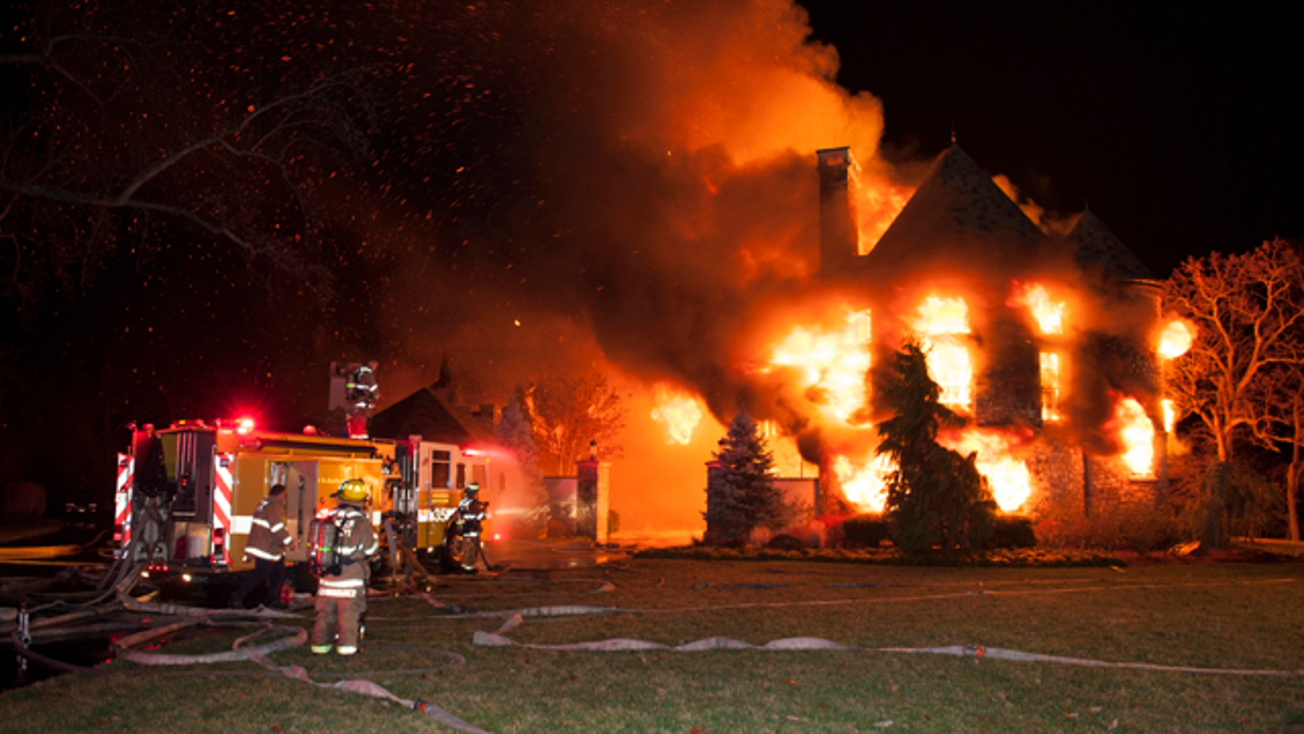 Jan. 19, 2015: Firefighters battle a four-alarm fire at a home on Childs Point Road, in Annapolis, Md. (AP Photo/Capital Gazette, Glenn A. Miller)