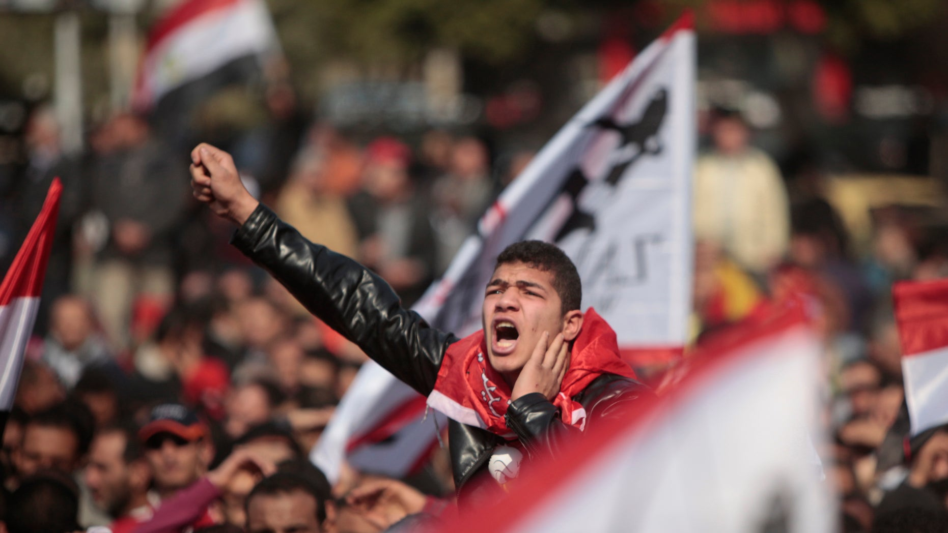 Feb. 2, 2012: An Egyptian soccer fan shouts anti-ruling military council slogans during a protest at Sphinx square in Cairo, Egypt, against killing of at least 74 people in the country's worst ever soccer violence.