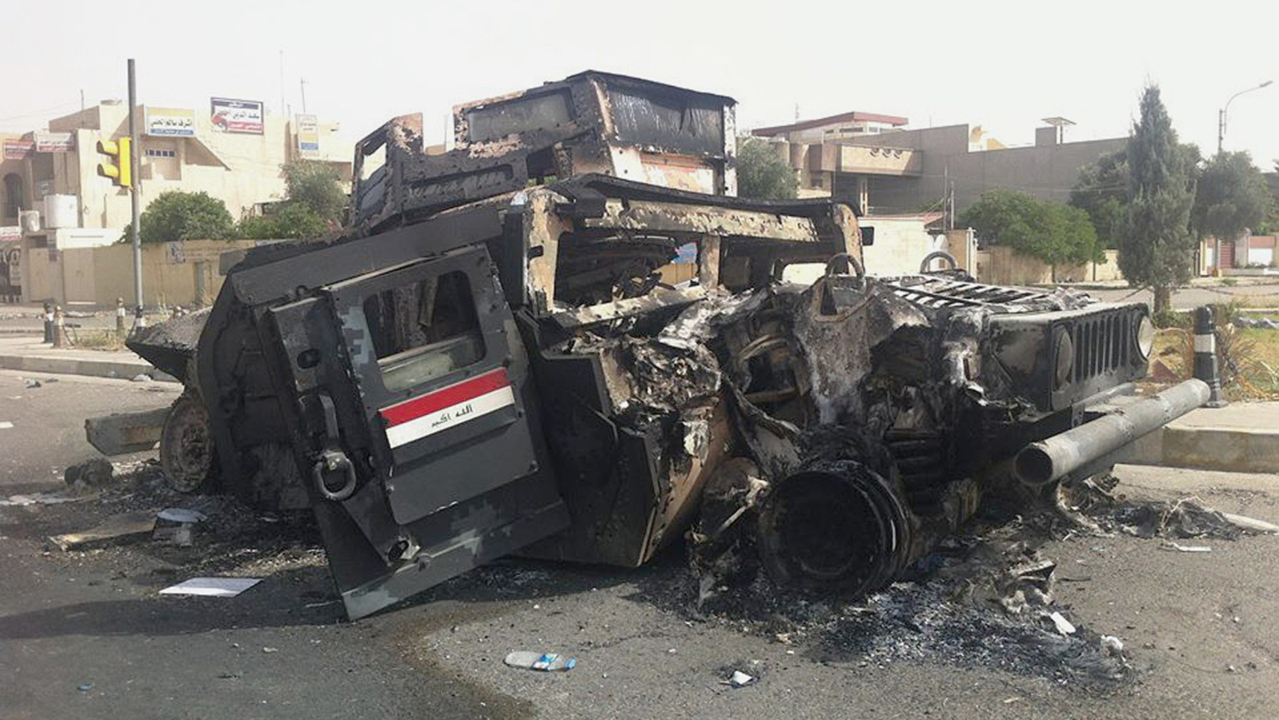 June 12, 2014 - Burned Iraqi army armored vehicle in Mosul, Iraq. The Al Qaeda-inspired group that captured 2 key Sunni-dominated cities in Iraq this week vowed to march on to Baghdad, raising fears about the Shiite-led government's ability to slow the assault following the insurgents.