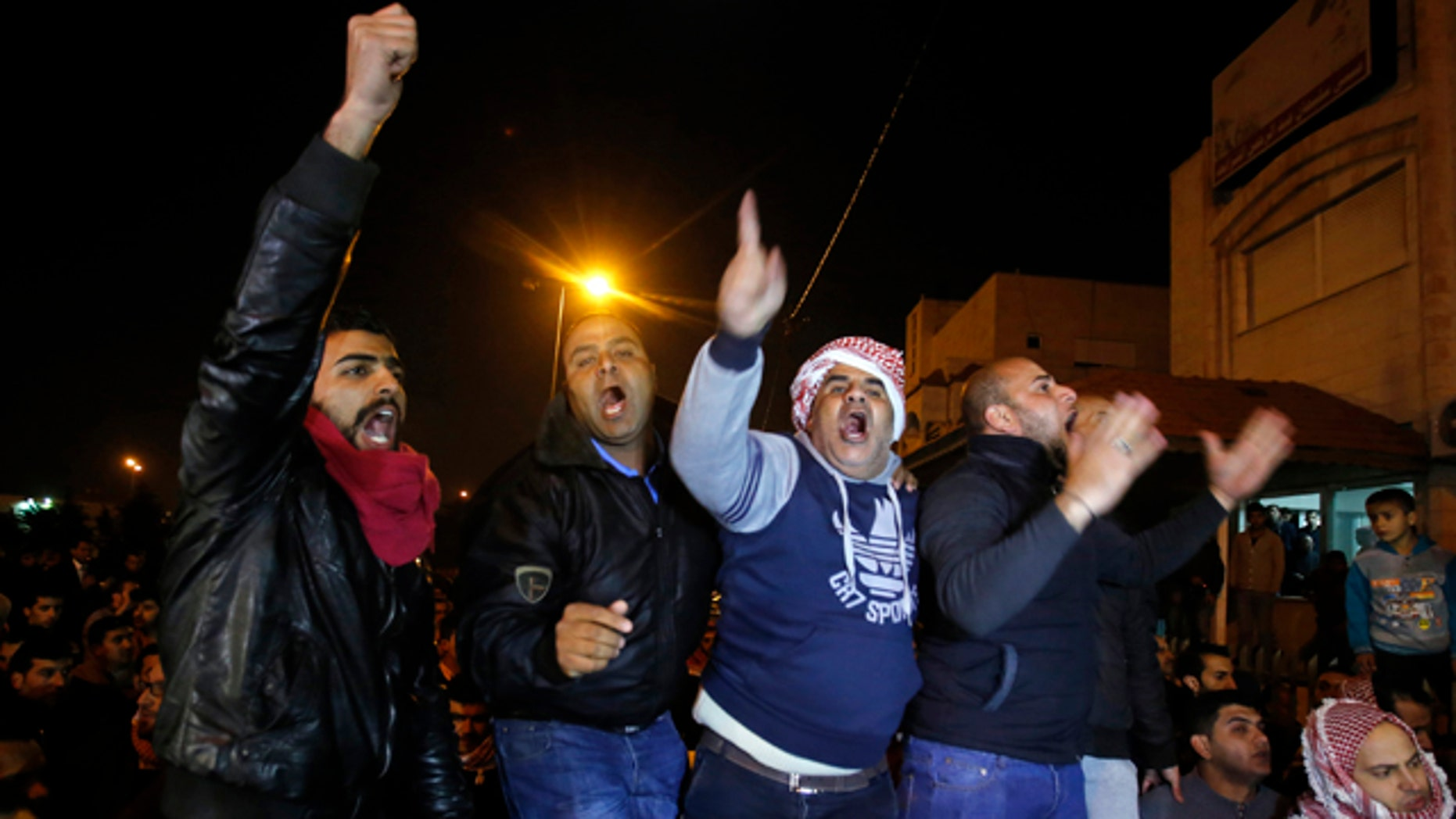 Feb. 3, 2015: Supporters and family members of Jordanian pilot Lt. Muath al-Kaseasbeh express their anger of his reported killing outside the tribal gathering chamber in Amman, Jordan. (AP Photo/Raad Adayleh)