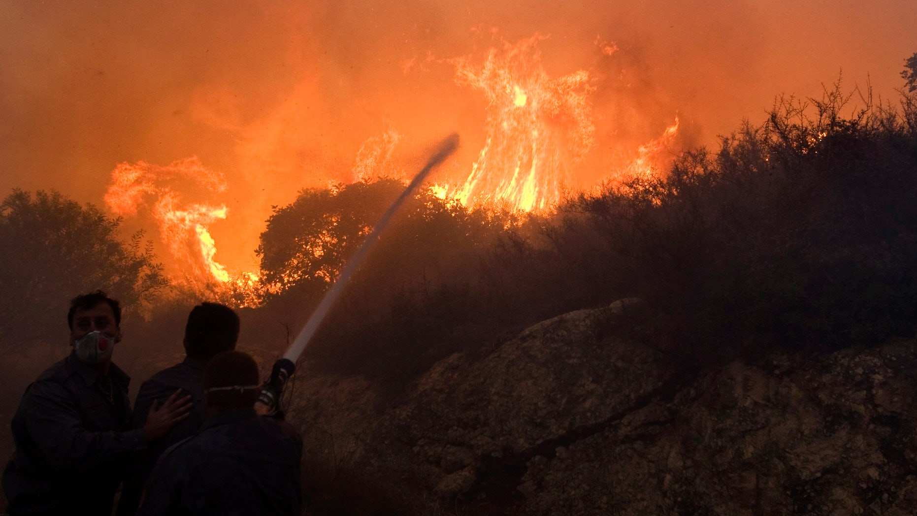 Dec. 3: Firefighters try to extinguish the flames in Tirat Hacarmel, northern Israel.