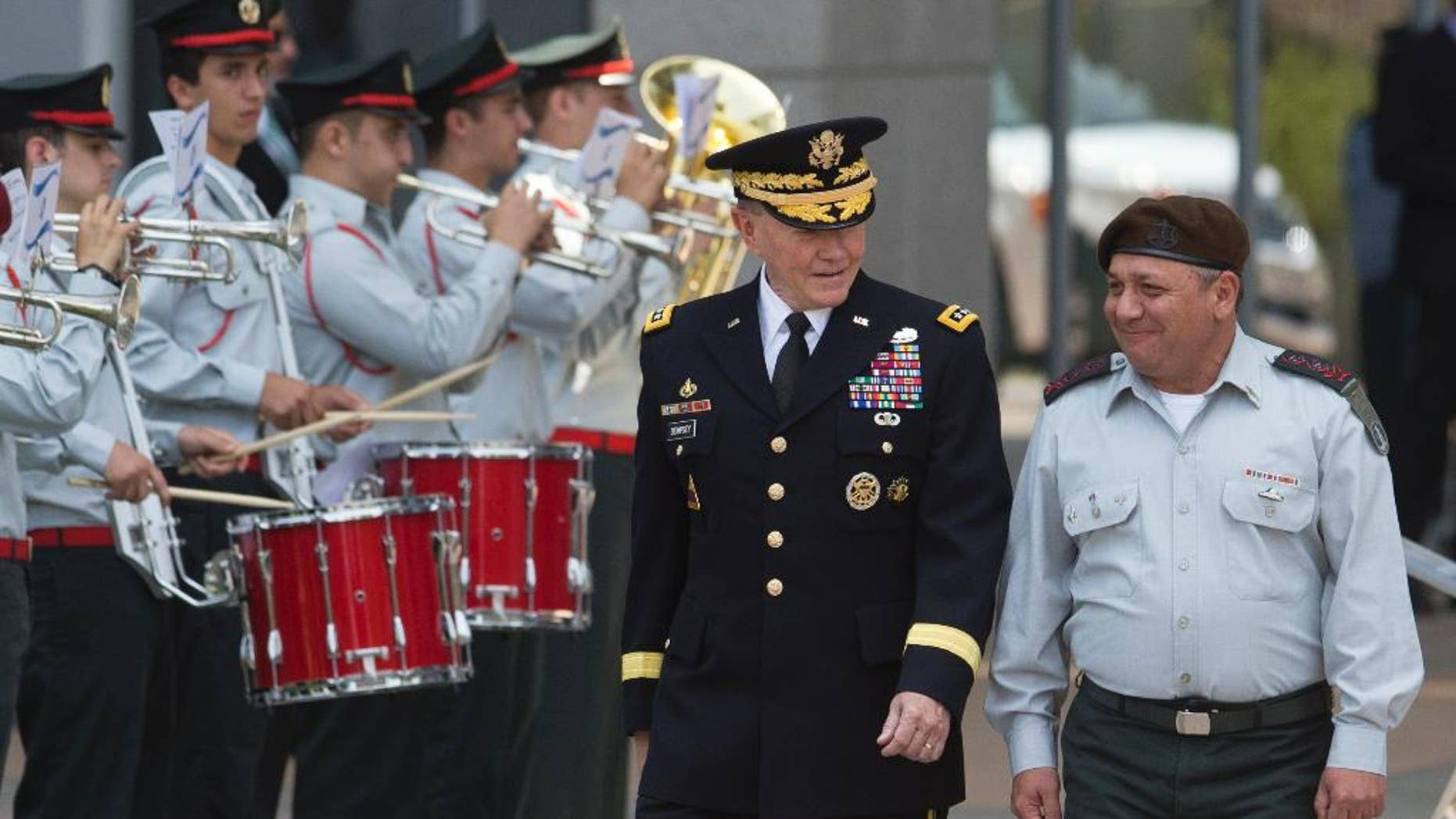 Outgoing Joint Chiefs Chairman Gen. Martin Dempsey, left,  and Israeli Chief of Staff Lt. Gen. Gadi Eizenkot review an honor guard during a welcoming ceremony in a military base in Tel Aviv, Israel, Tuesday, June 9, 2015. The Chairman of the U.S. Joint Chiefs of Staff General Martin E. Dempsey landed on Monday evening in Israel for an official visit. (AP Photo/Ariel Schalit)